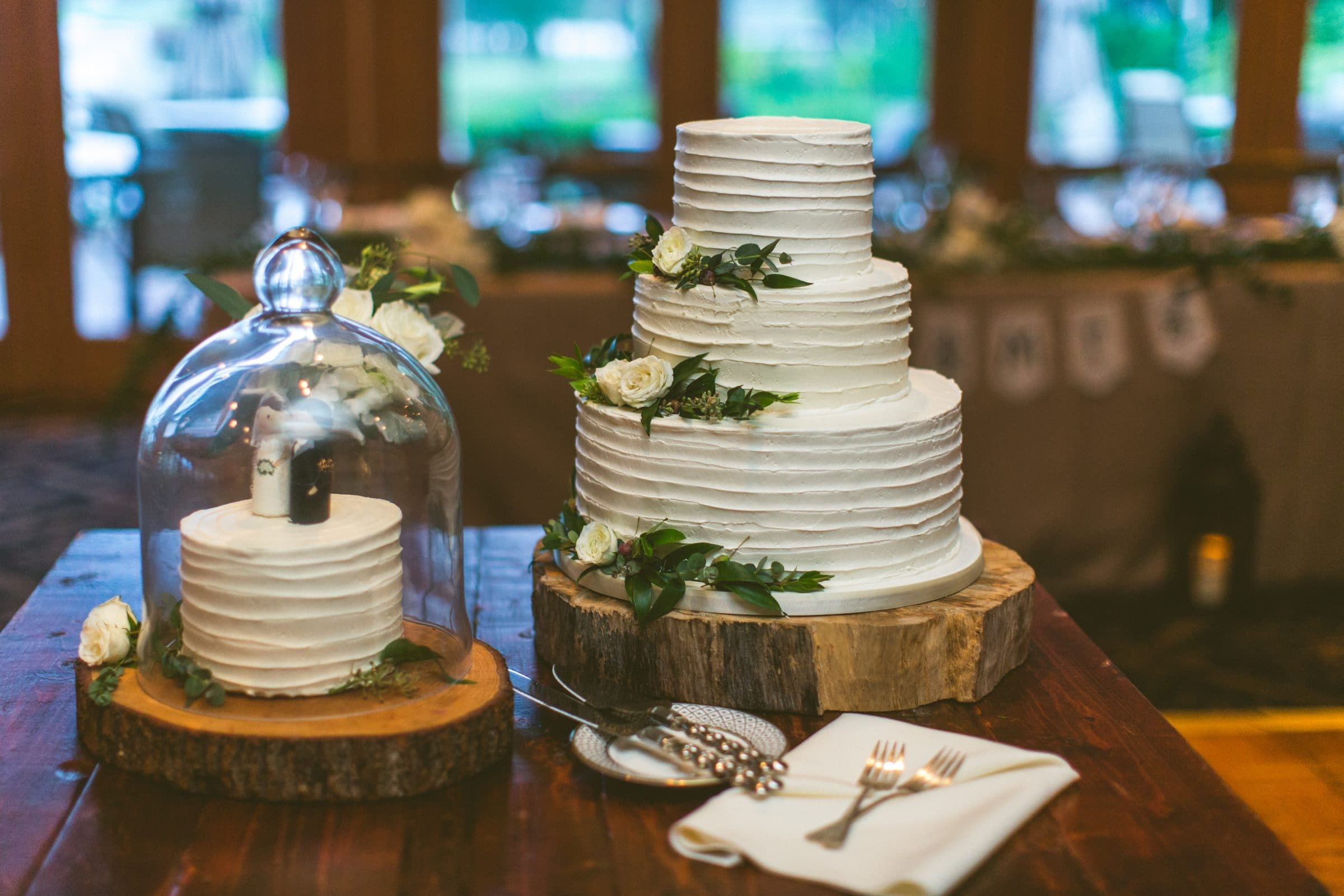 Simple ruffle wedding cake on rustic wooden stand