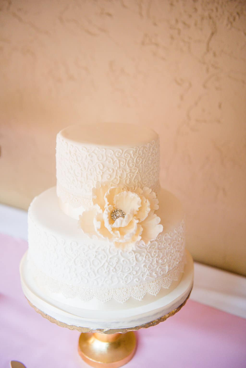 Simple wedding cake with white filigree