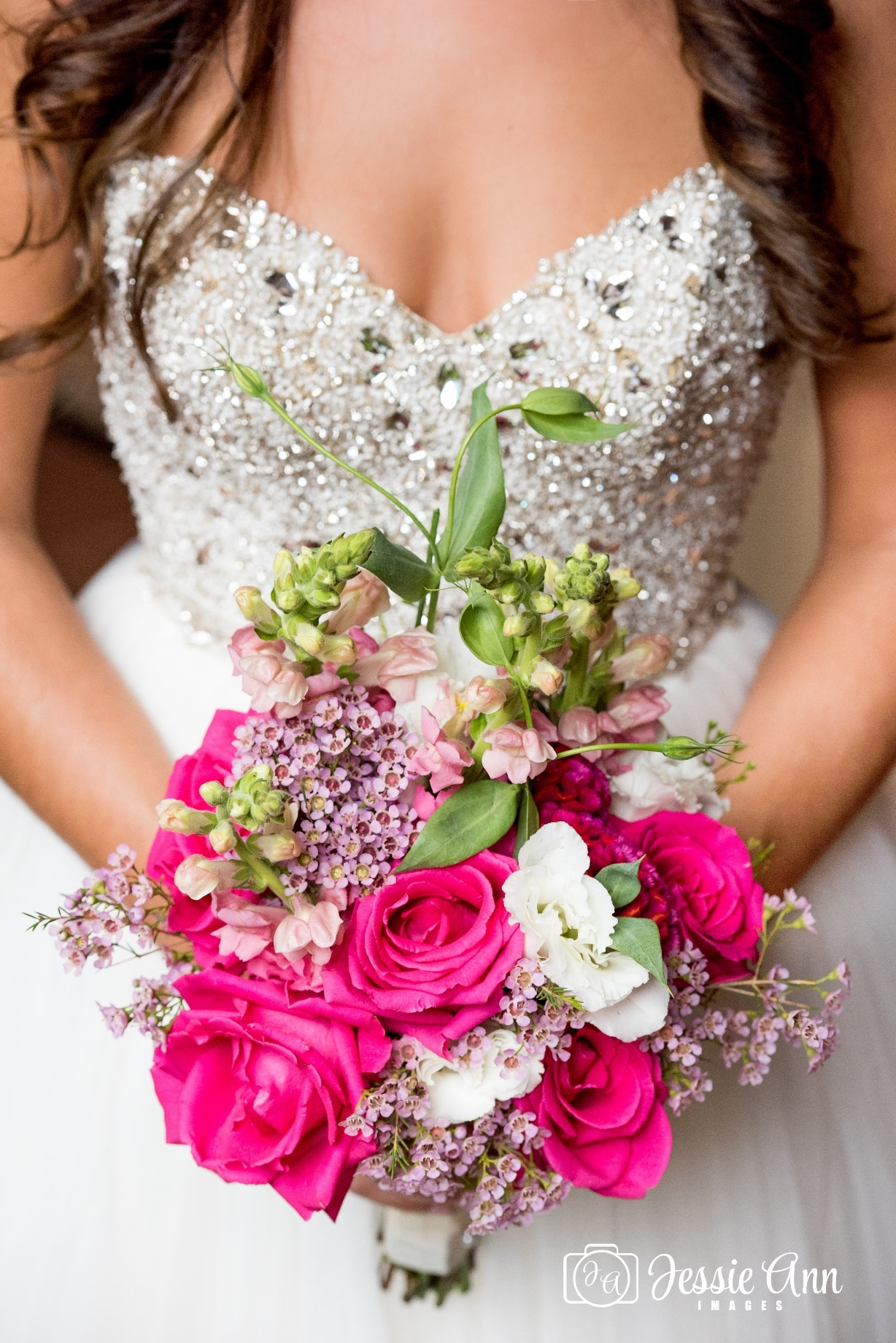 bride with bright pink bouquet
