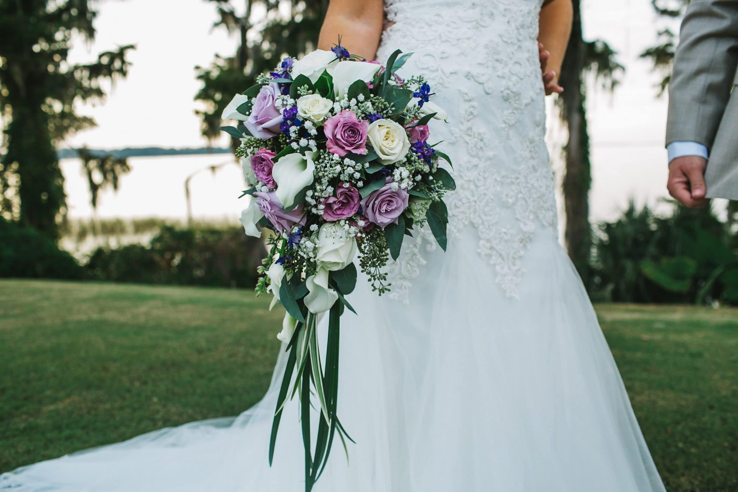 bridal gown with purple bouquet