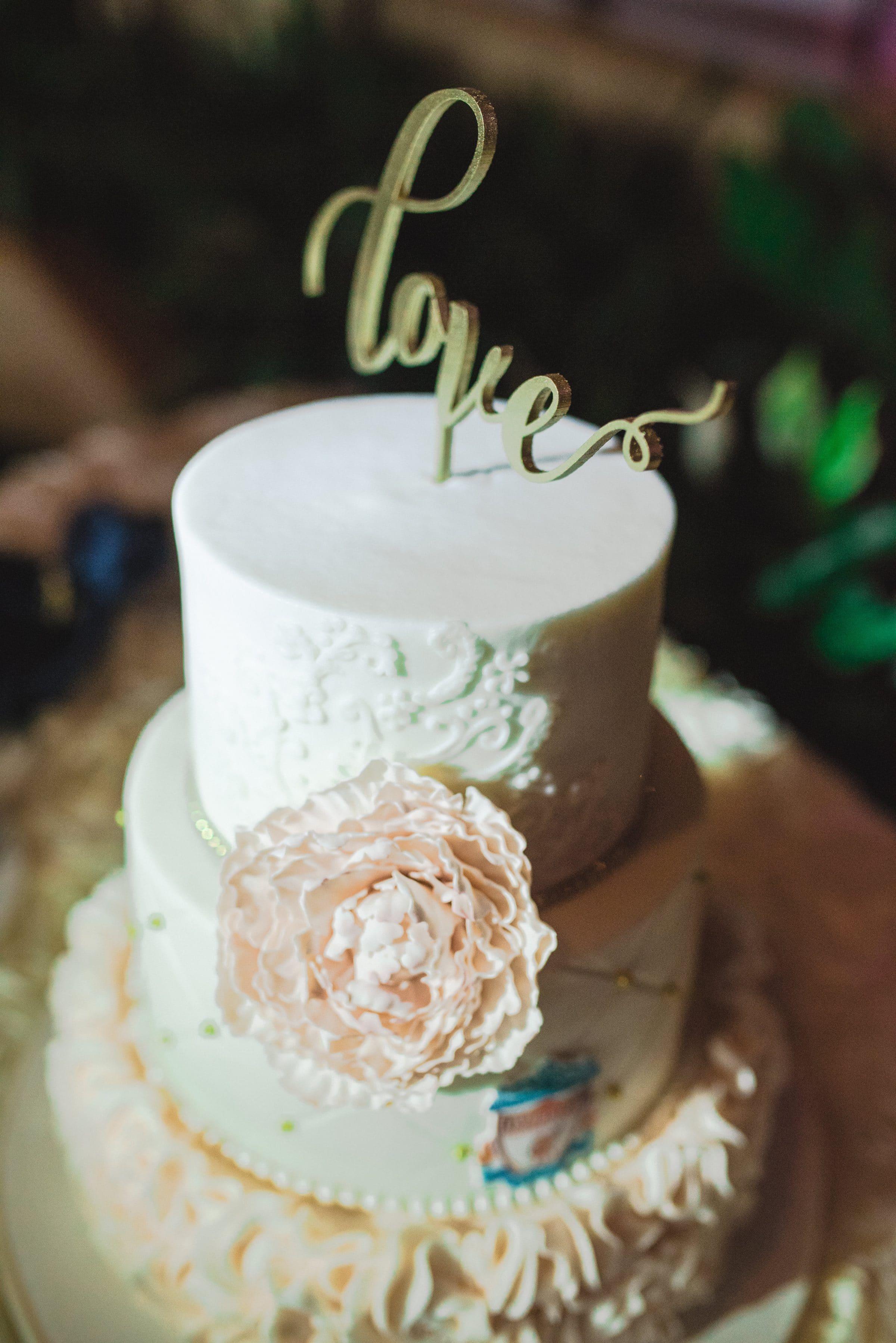 """""""love"""" wedding cake topper"""