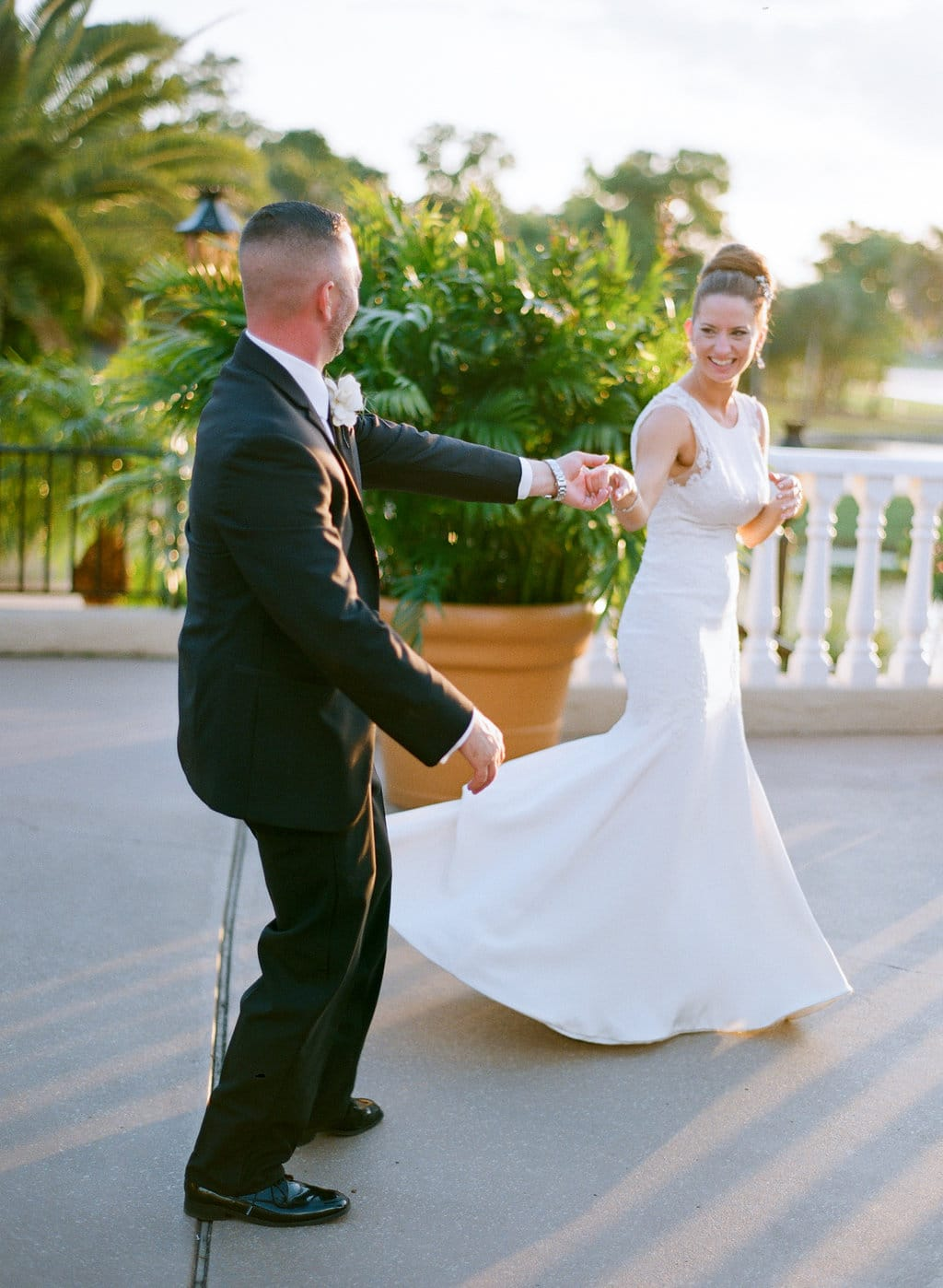 Groom twirling bride on outdoor patio at Mission Inn Resort