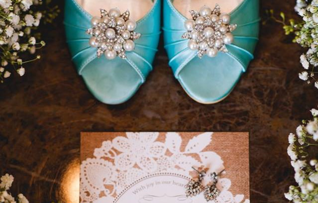 Closeup of bride's shoes and earrings