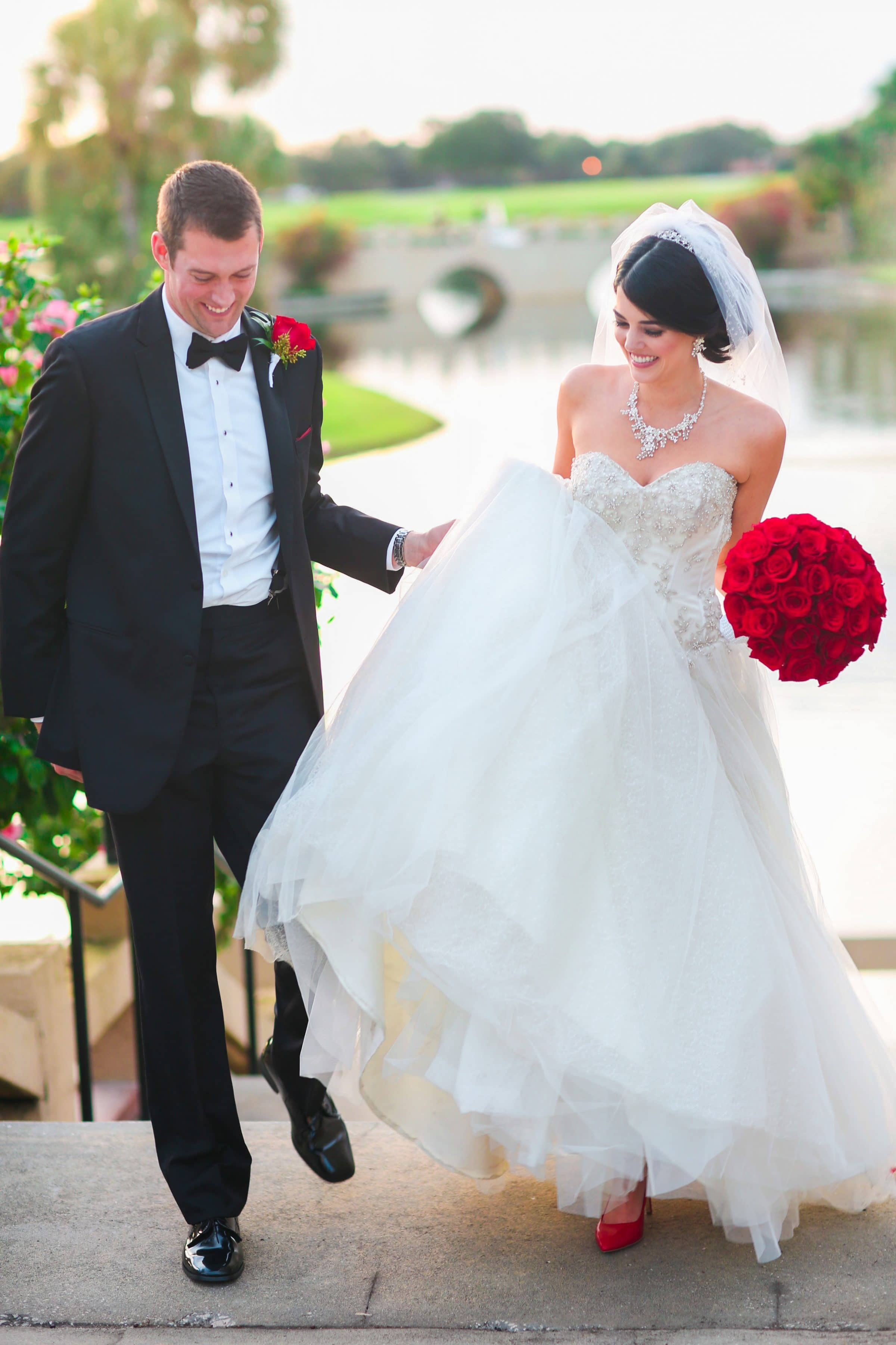 smiling bride and groom at top of outdoor staircase