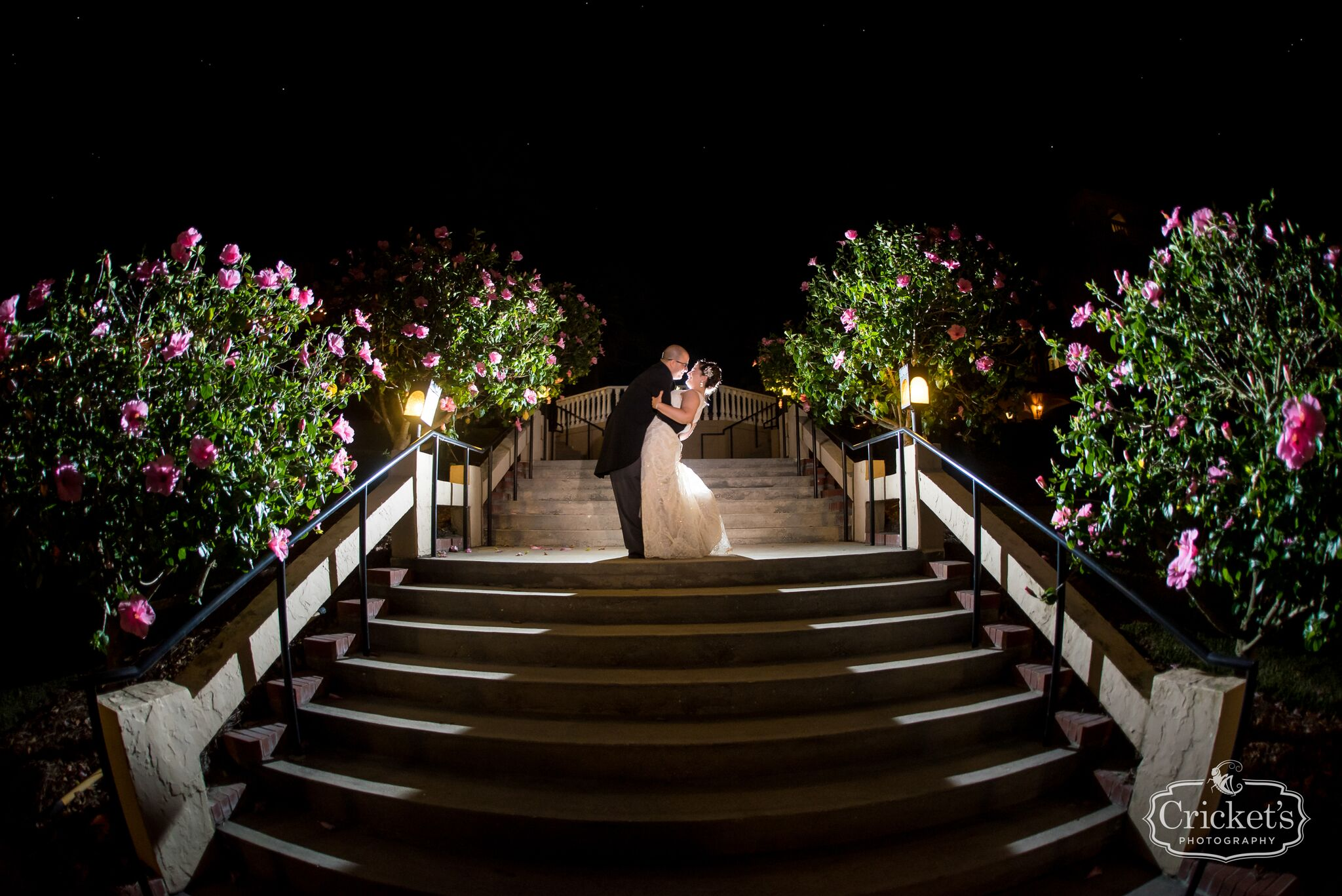 Bride and groom dramatic staircase shot at nighttime