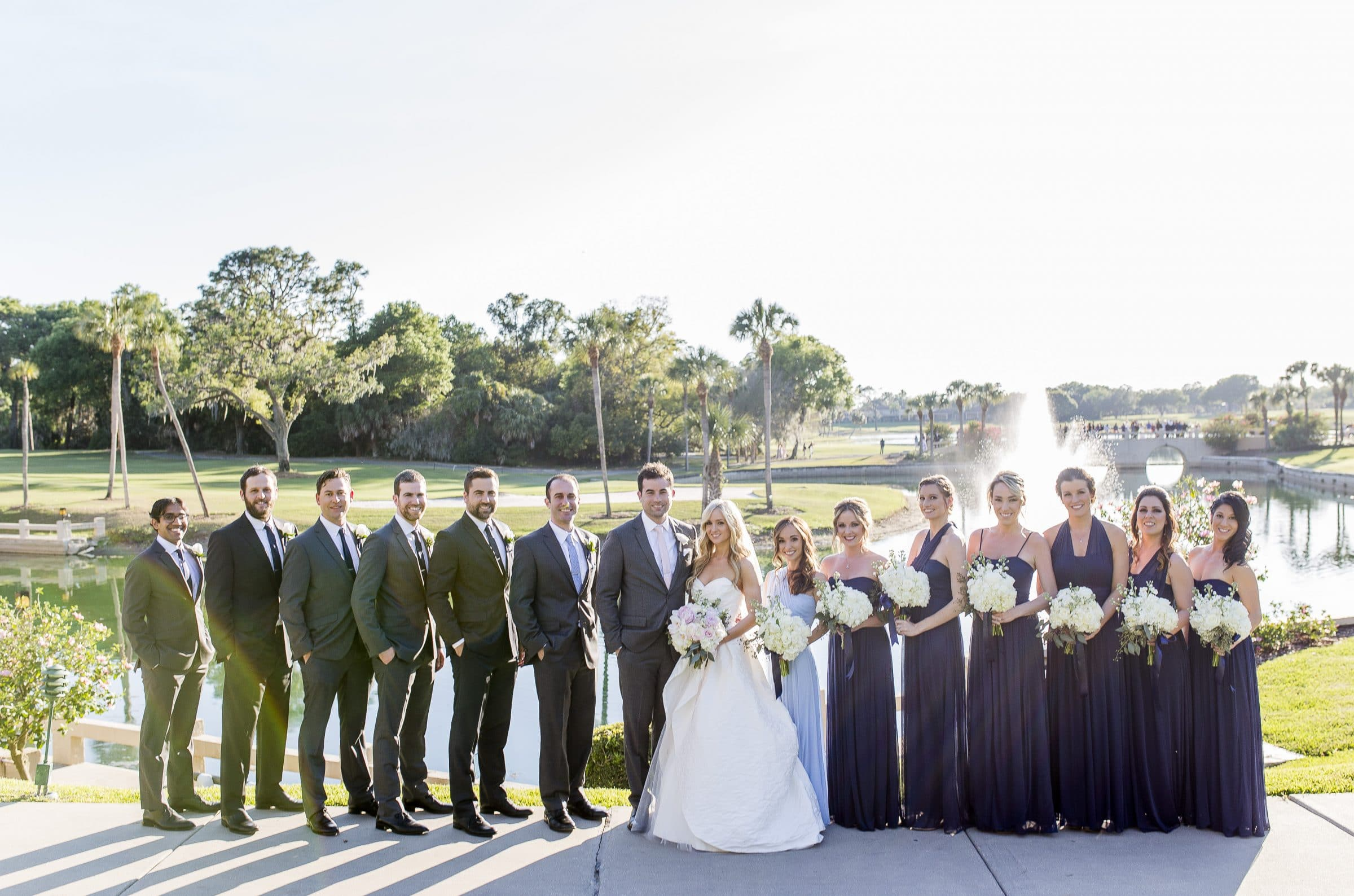 Bride and groom with wedding party overlooking golf course at Mission Inn