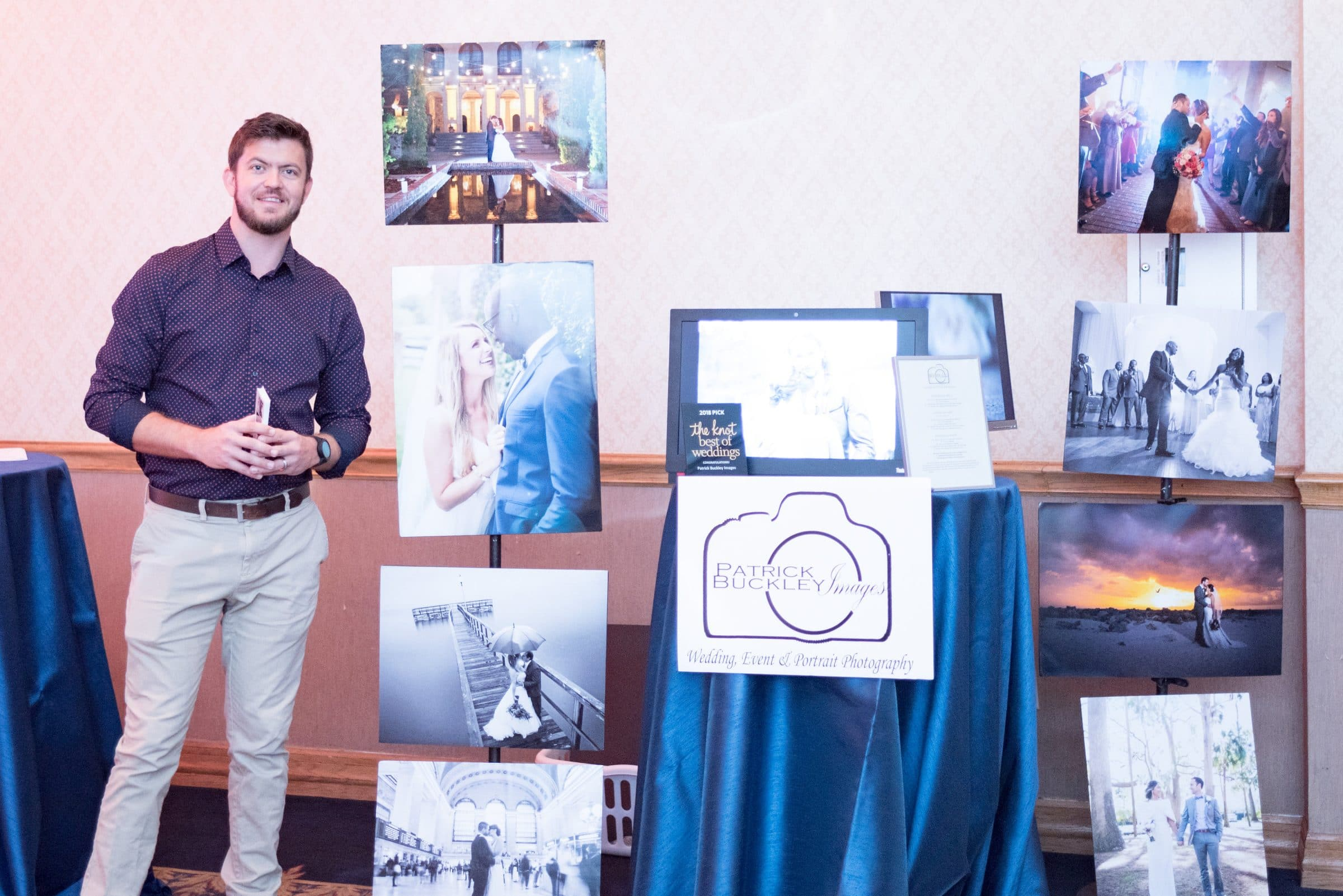 Orlando Wedding Photographer standing next to collection of canvases