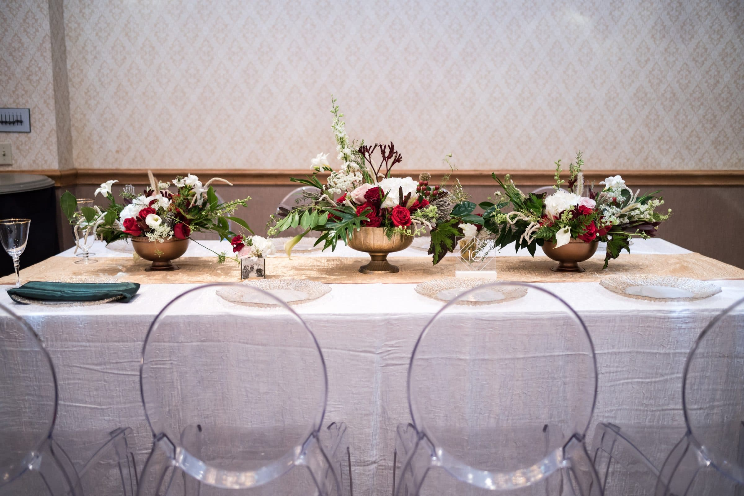 White Table with Clear Chairs and Christmas Floral