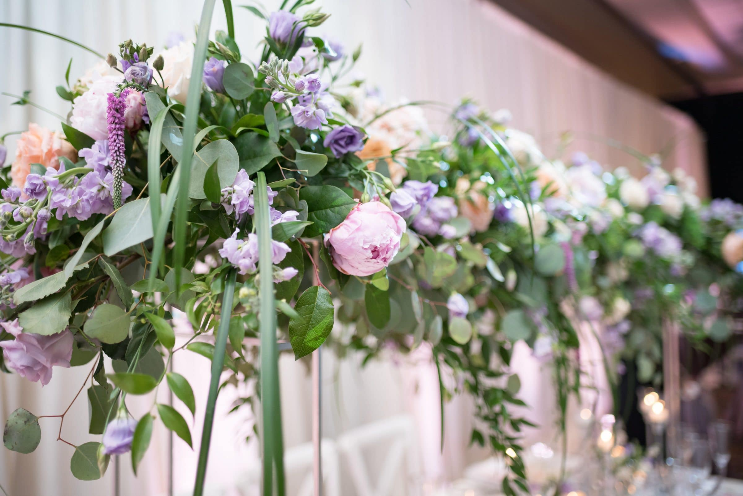 pink peonies with purple floral and greenery
