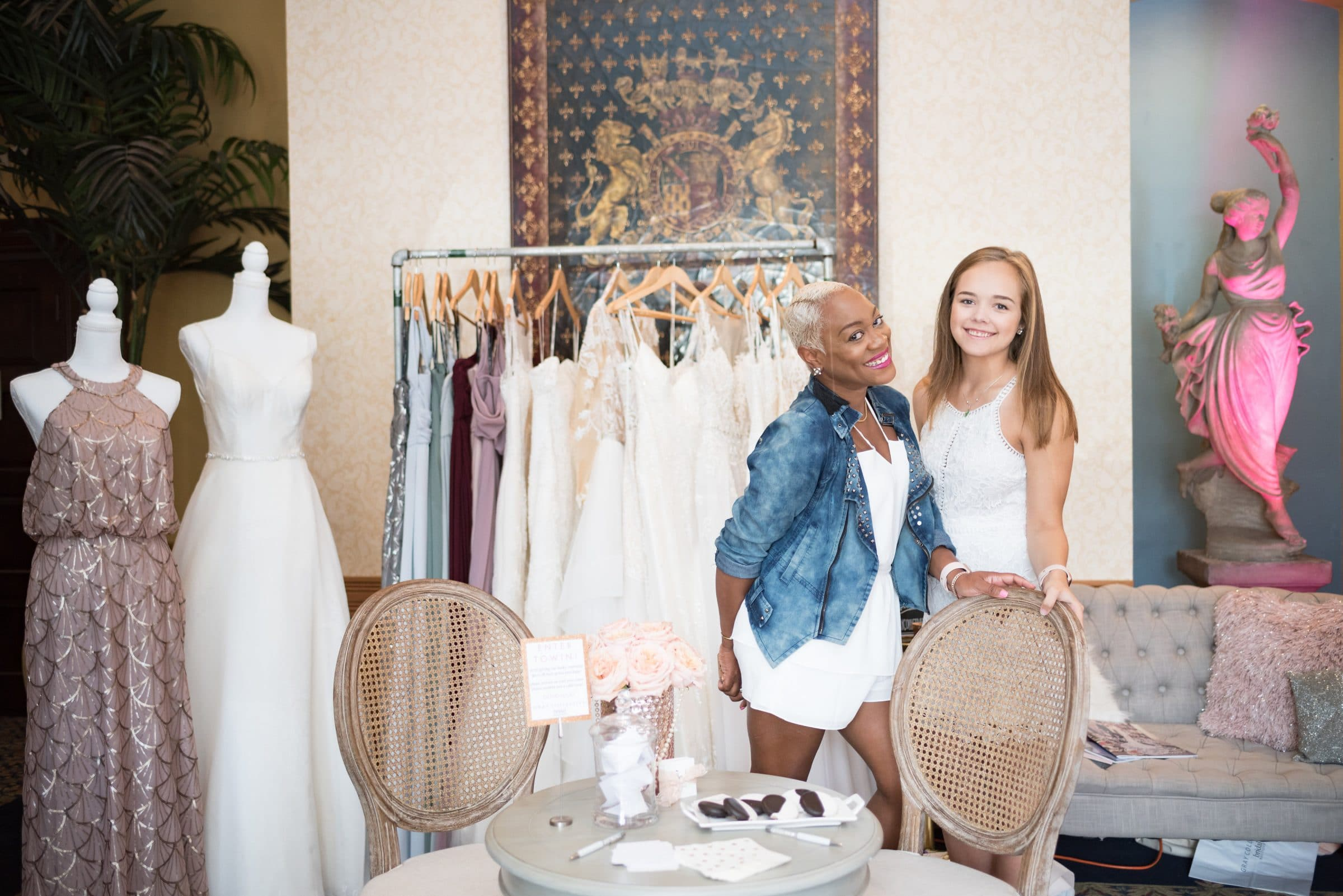 Wedding dresses with two women sales managers