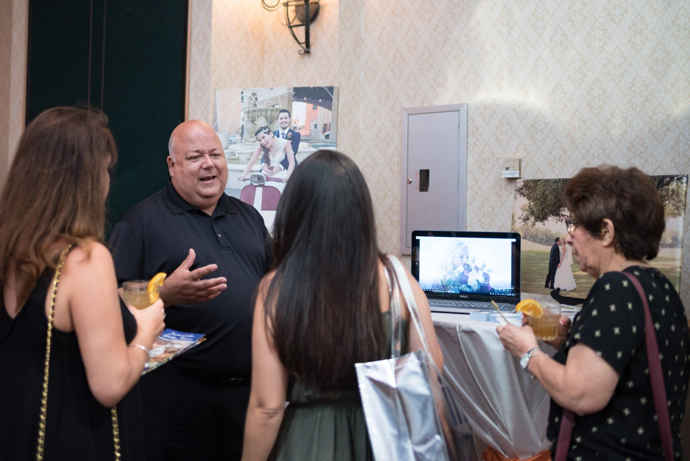 Male Wedding Photographer talking to brides at bridal show