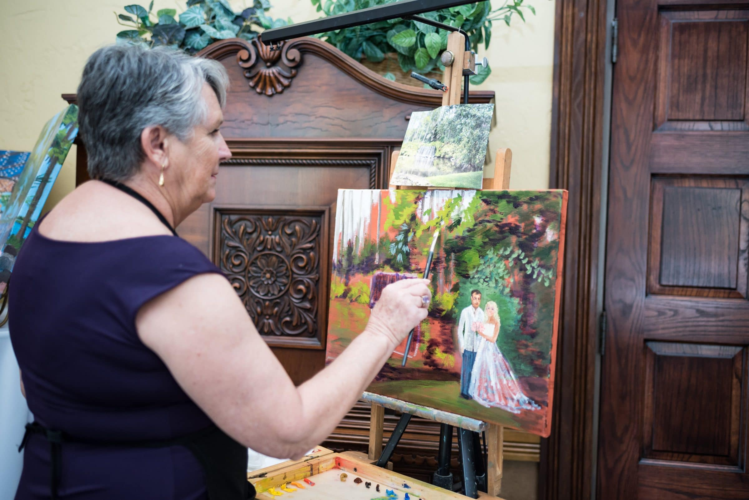 Woman Painting a watercolor of a waterfall