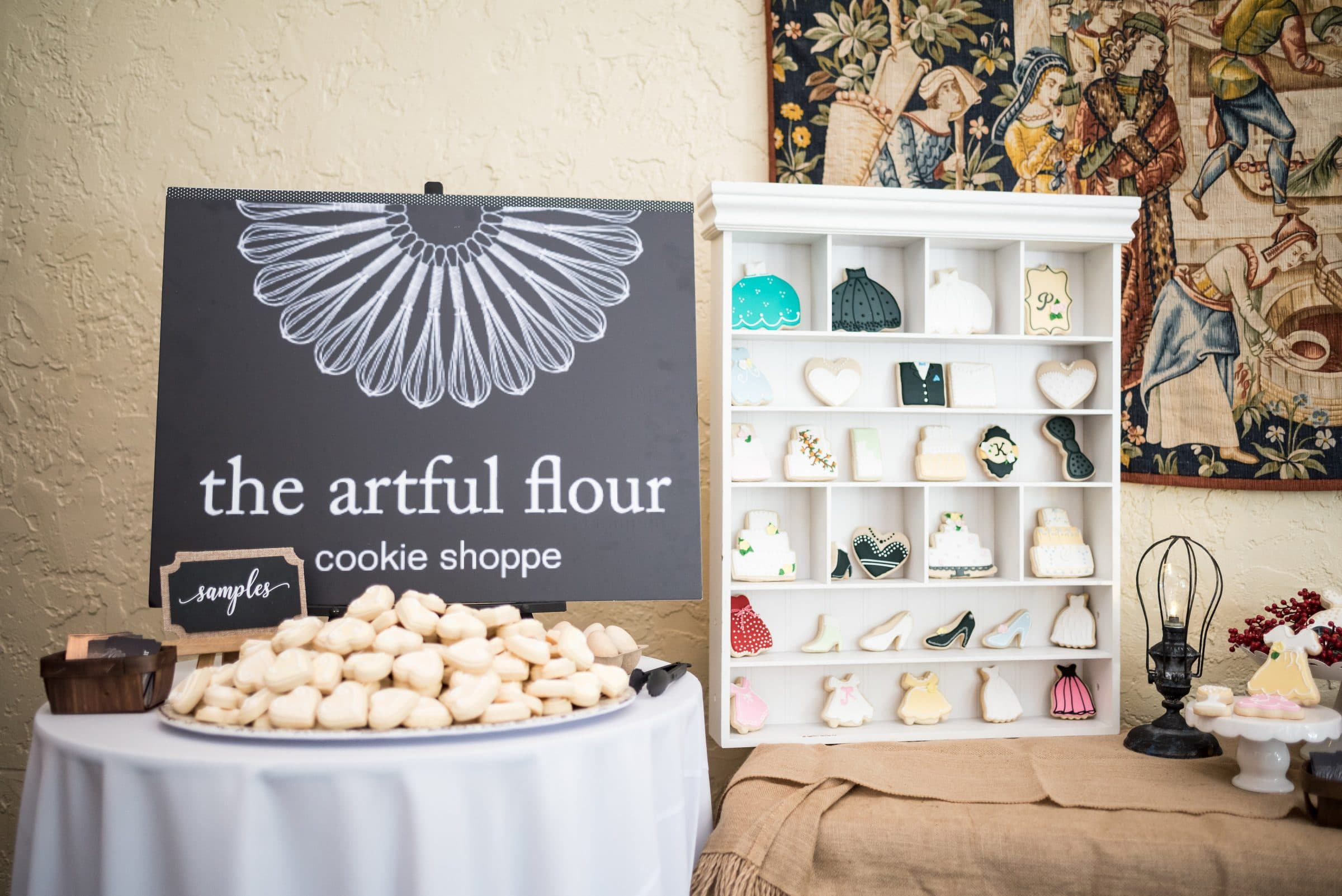 Display of Cookies with a sign that reads the Artful Flower