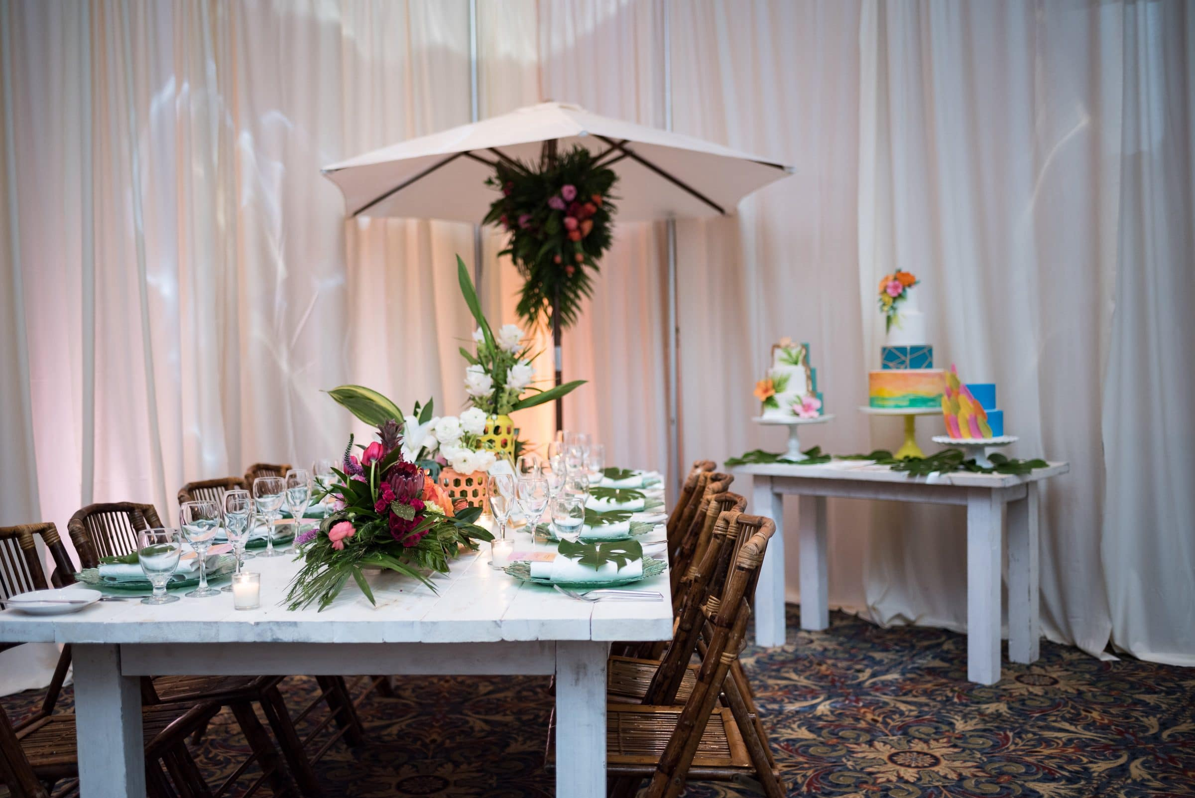 White Table with Bamboo Chairs and Floral
