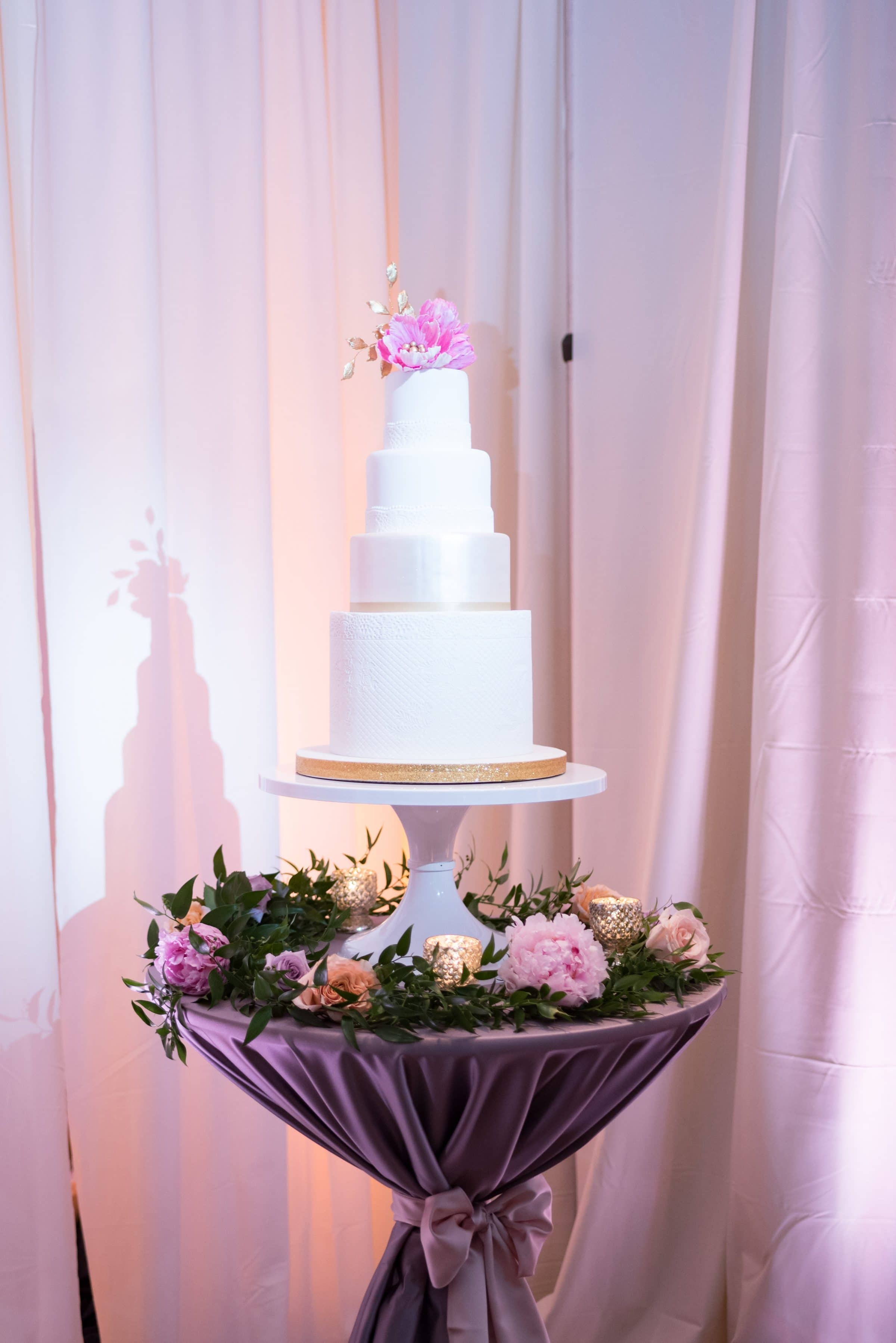 White Wedding Cake on Table with Fresh Floral