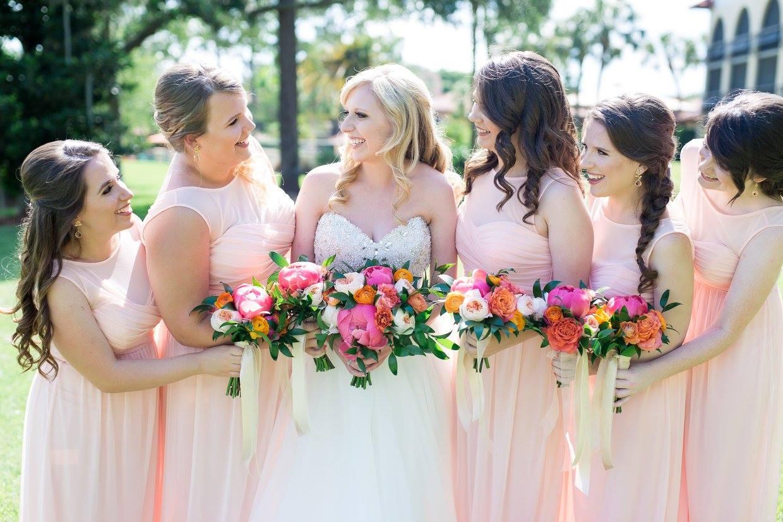 Bridesmaids in pink holding Summer Citrus Wedding Bouquet
