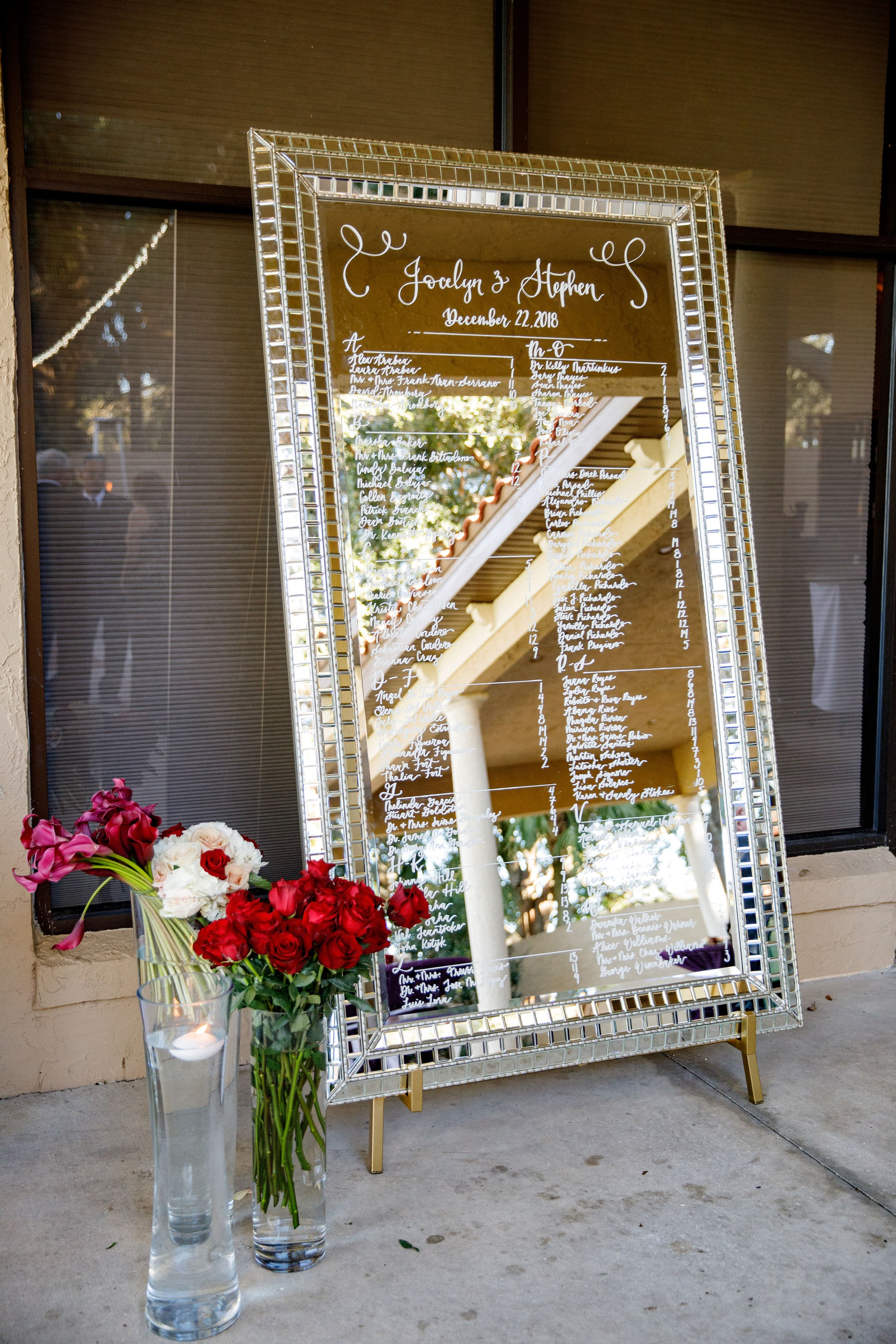 8ft silver mirror with names on it and fresh floral