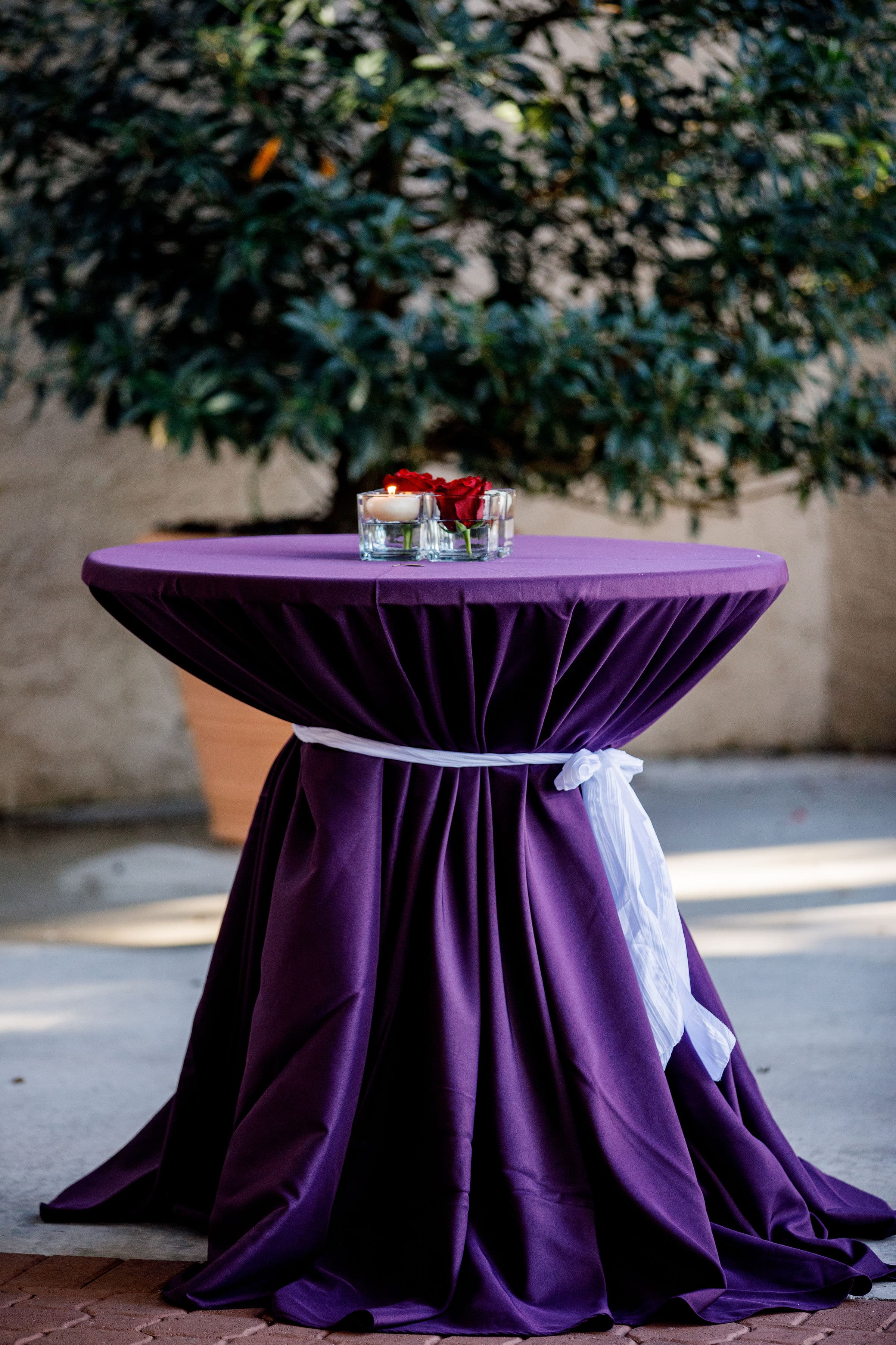 Cocktail Table Outside with Purple Linen