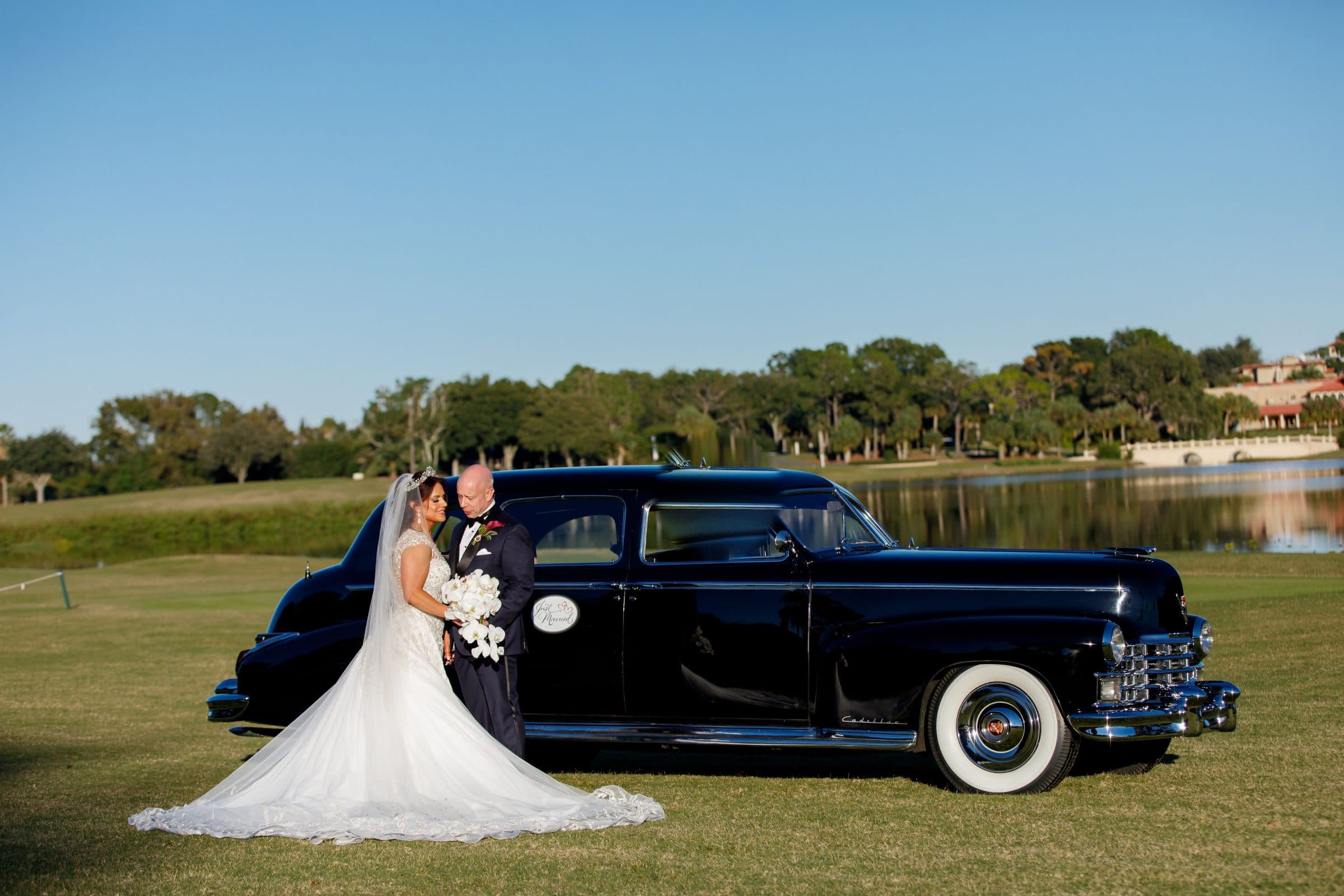 Bride and Groom in front of antique car on golf course at Mission Inn Resort