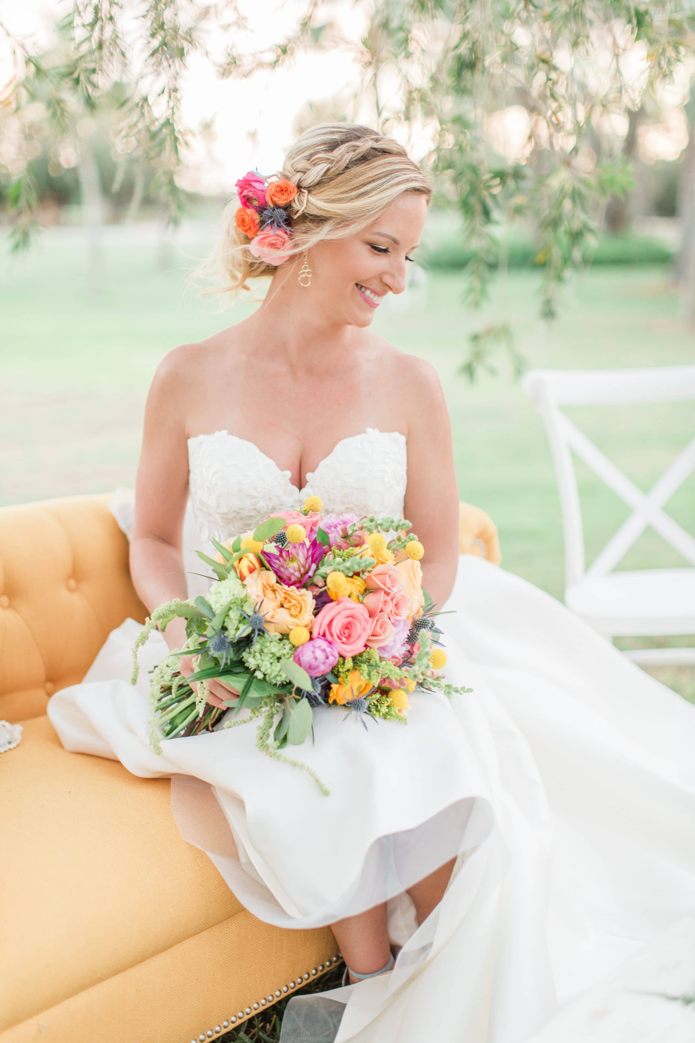 Bride on Couch Holding Sensational Spring Wedding Bouquet