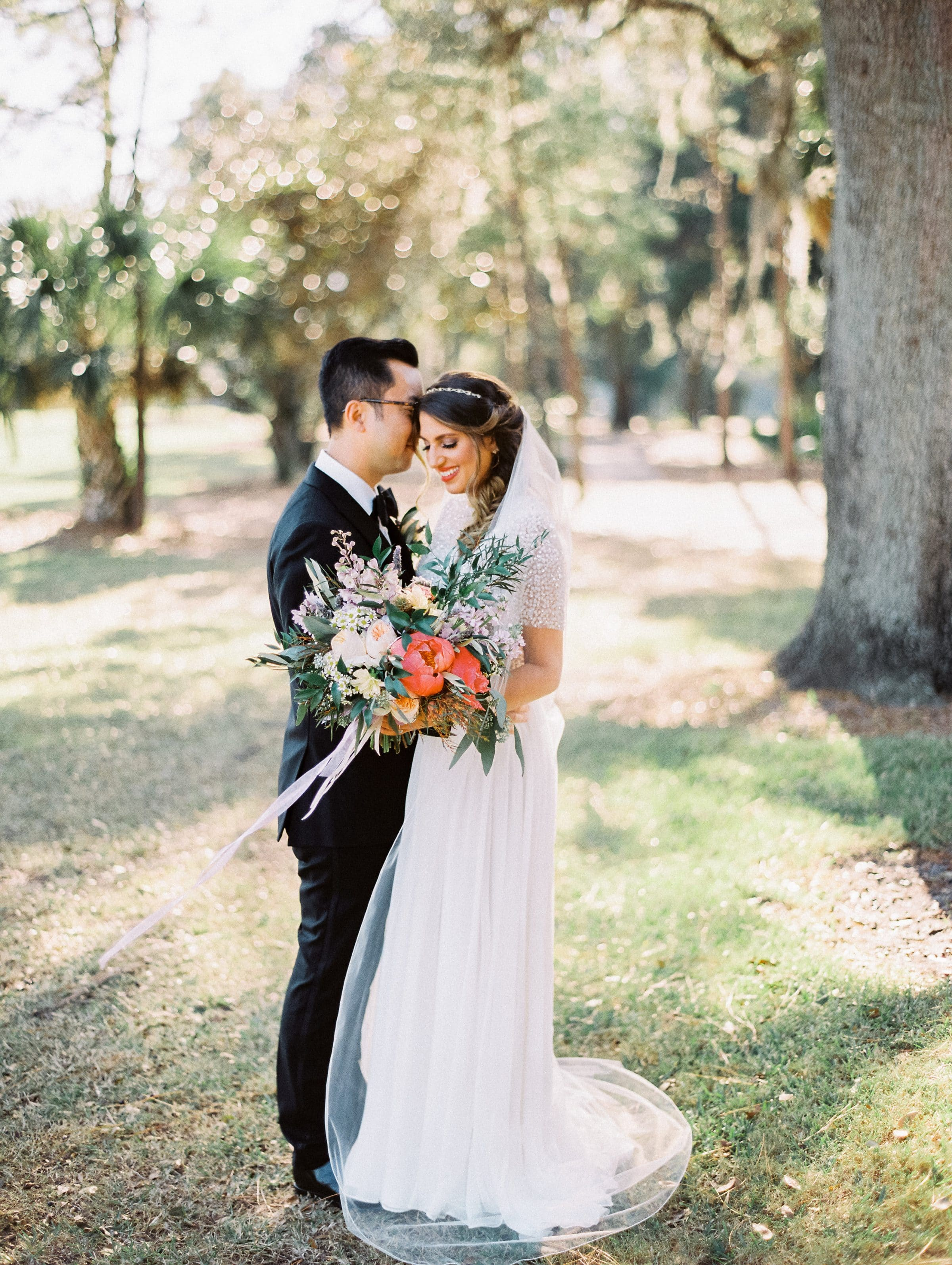 Bride and Groom in the Trees holding Show Stopping Wedding Bouquet