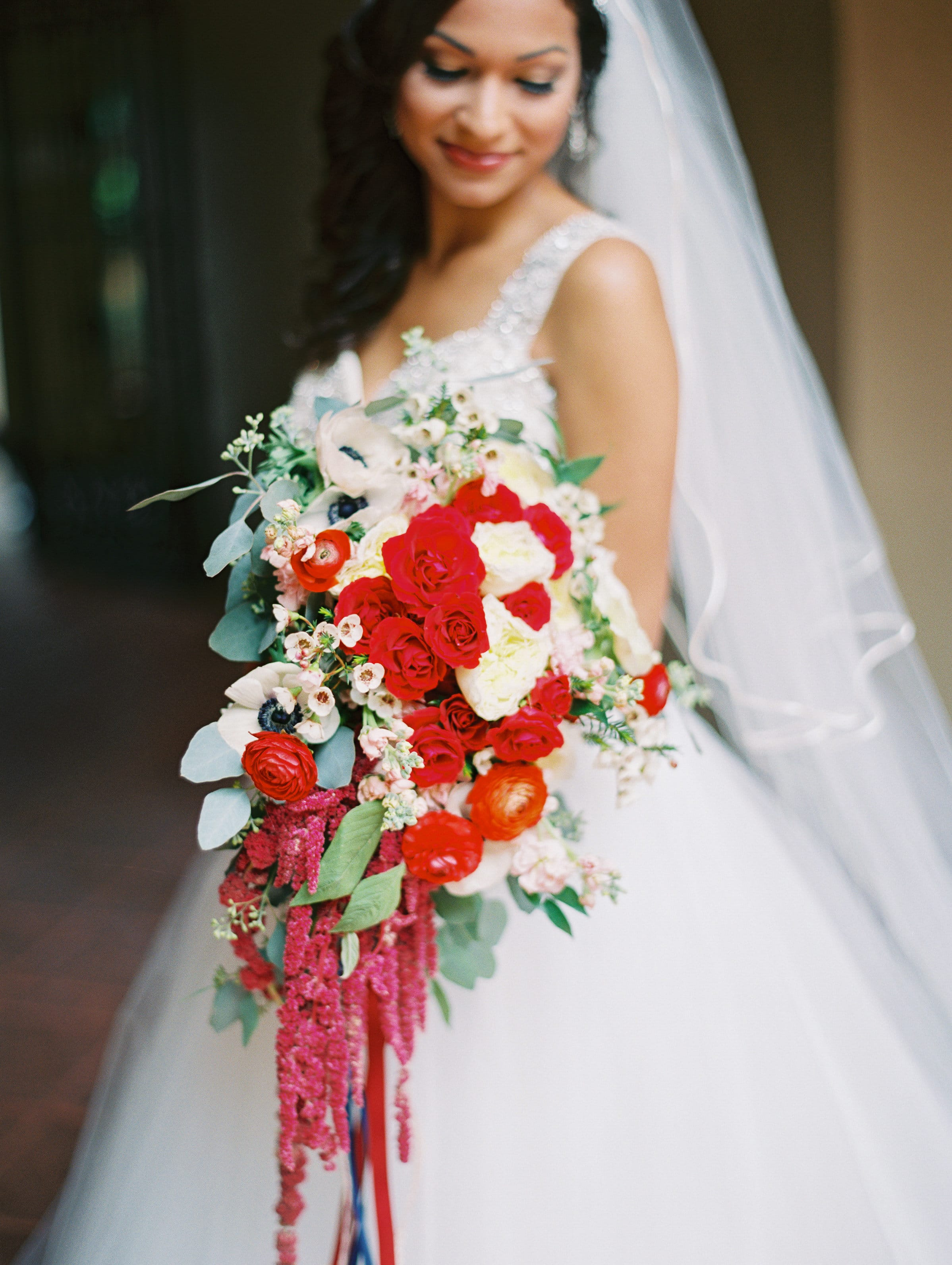 Bride Holding Romantic Red Wedding Bouquet