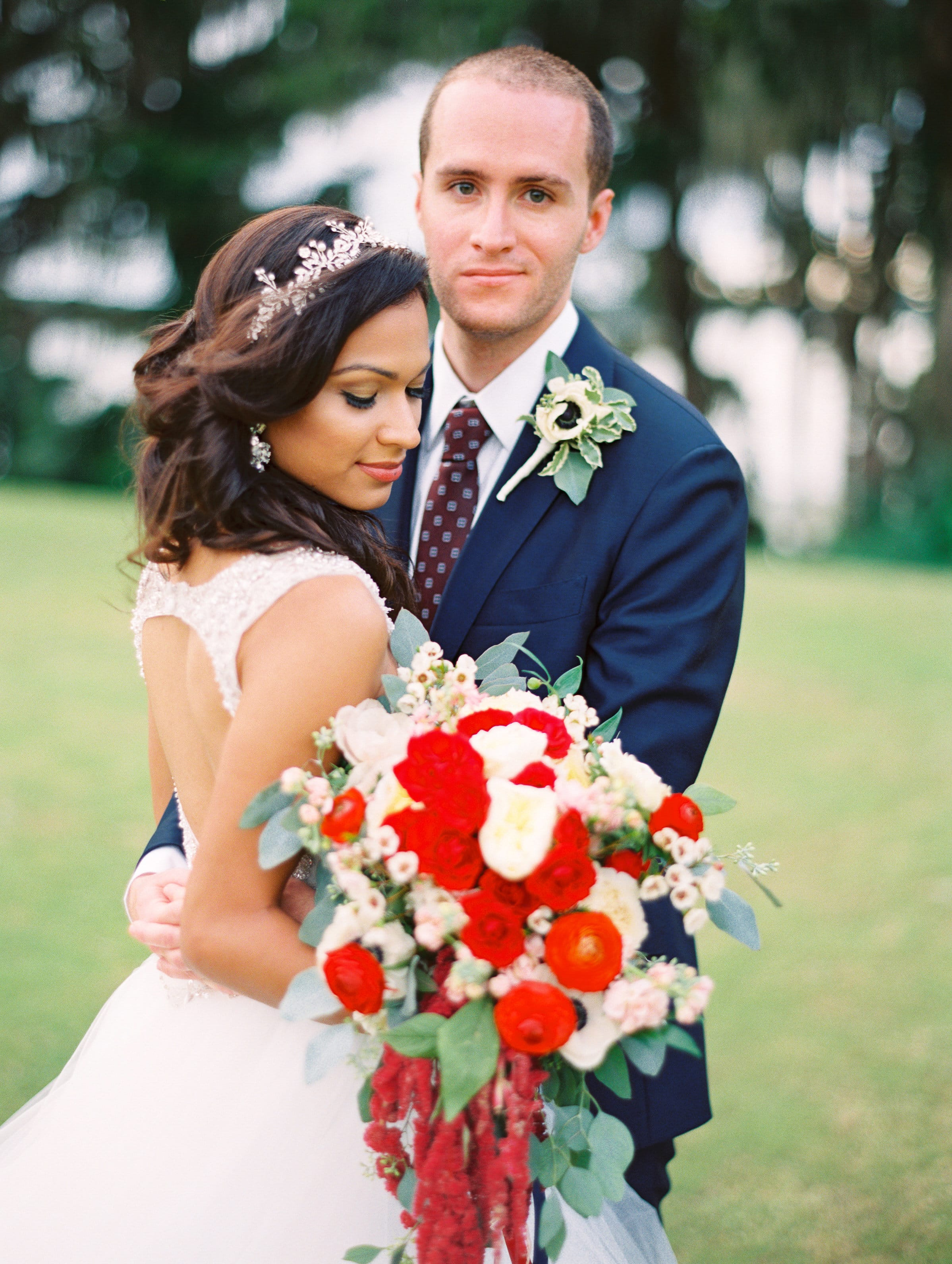 Groom with Bride holding Romantic Red Wedding Bouquet