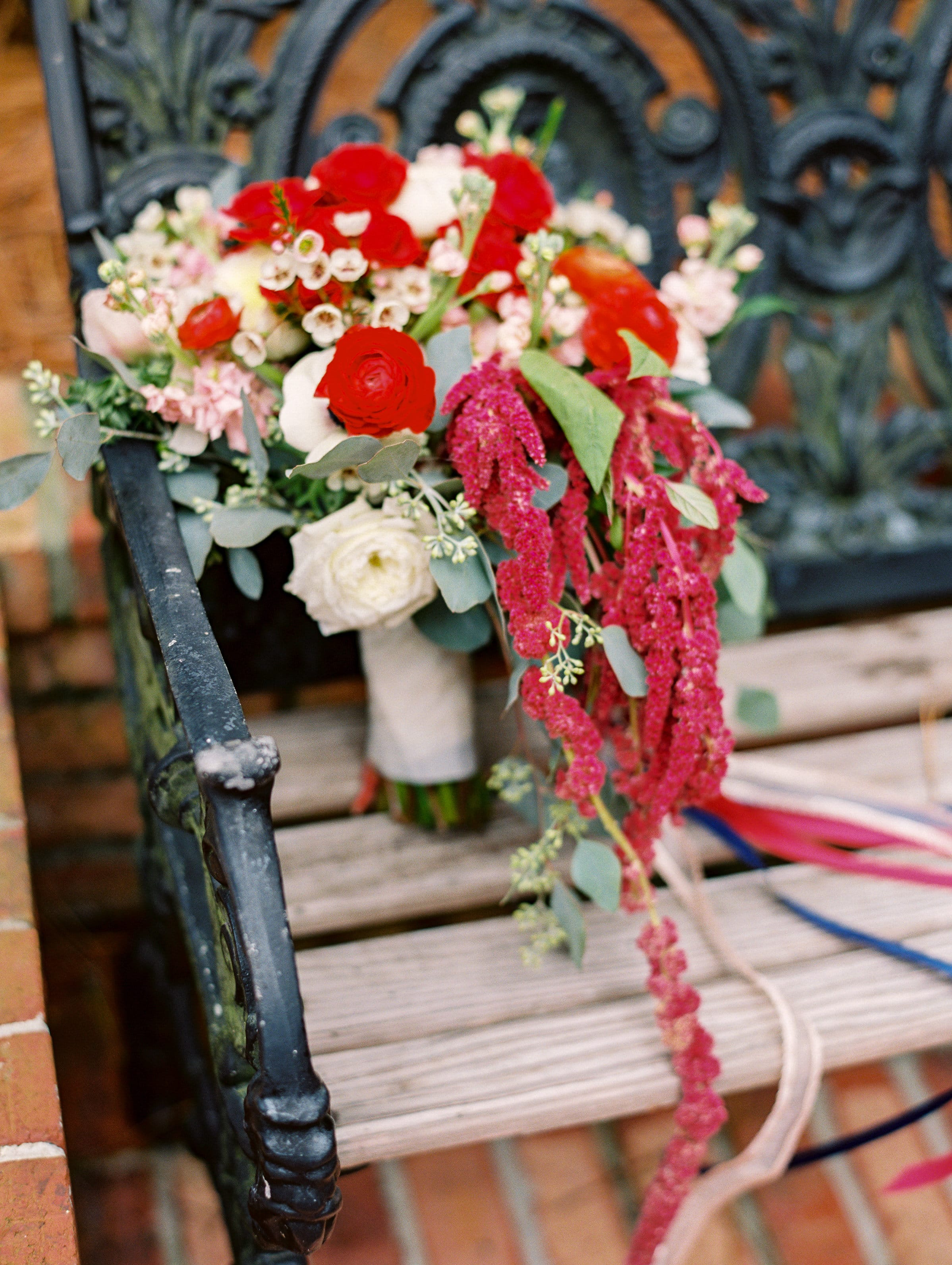 Romantic Red Wedding Bouquet on Bench