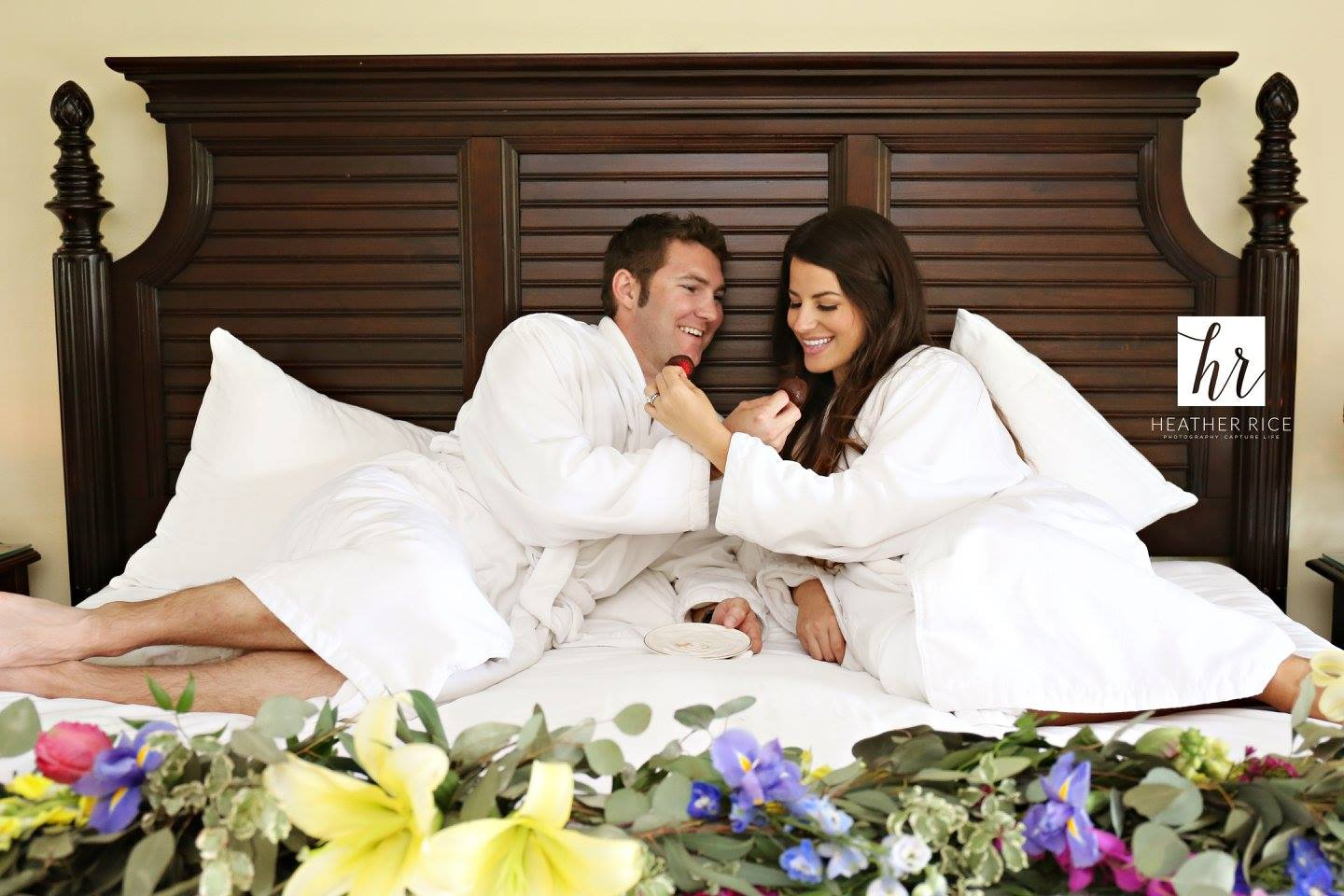 Bride and Groom in a hotel bed on wedding weekend