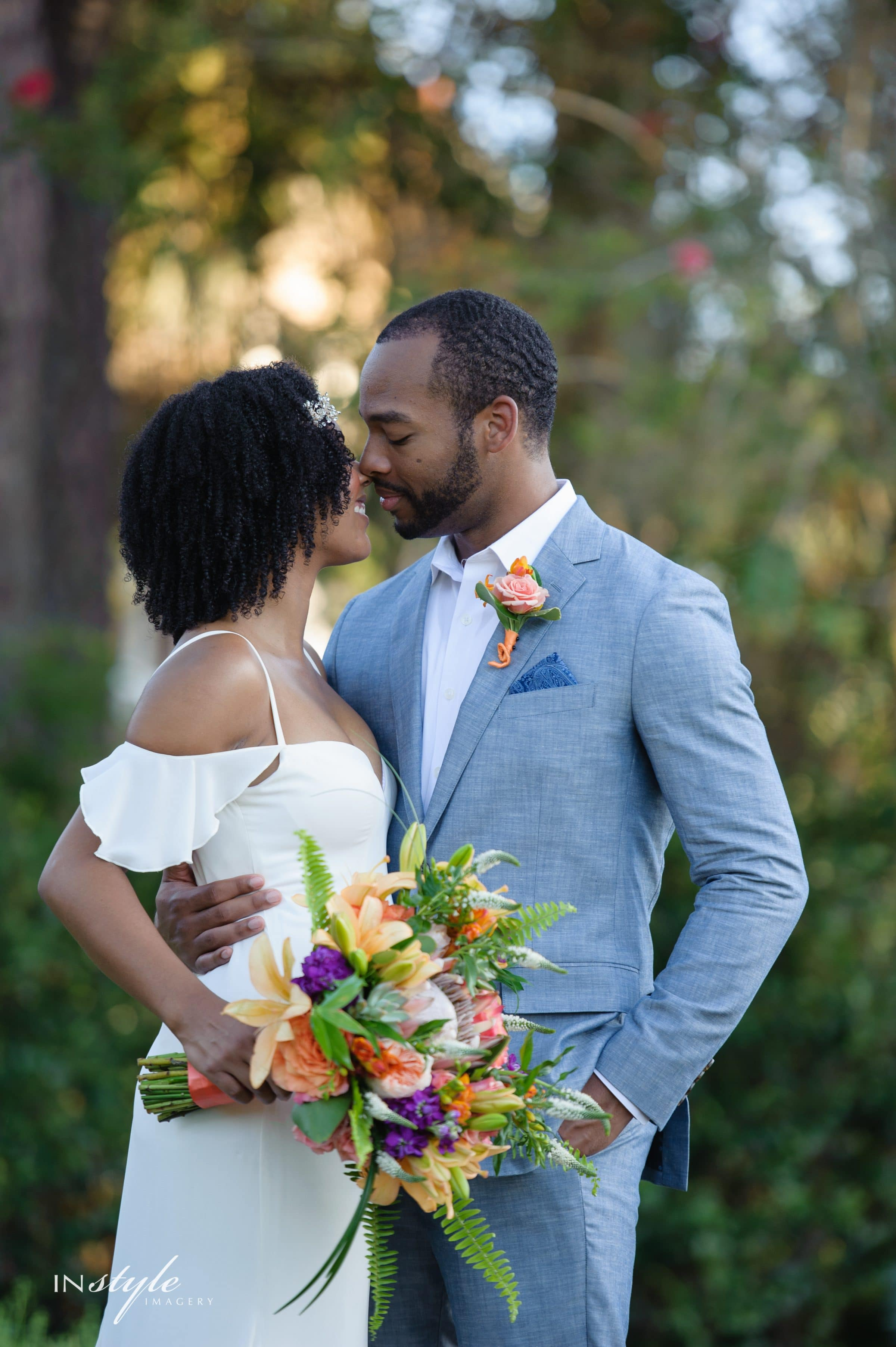 Groom Kissing Bride Holding Palm Springs Inspired Wedding Bouquet