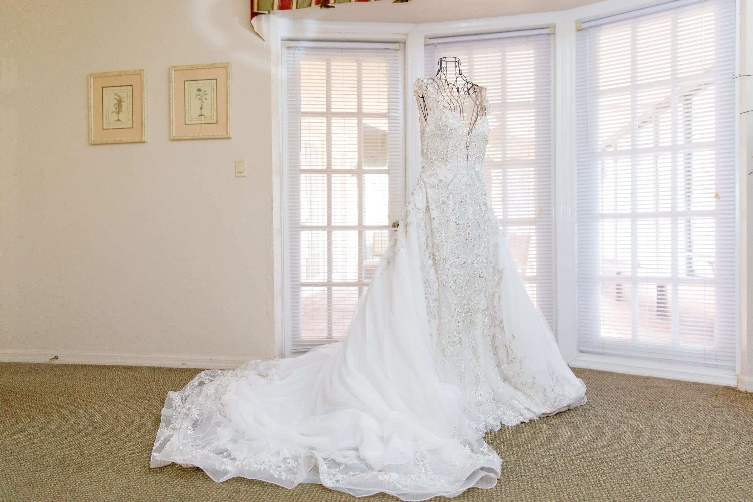 Wedding Dress hanging next to window in villa
