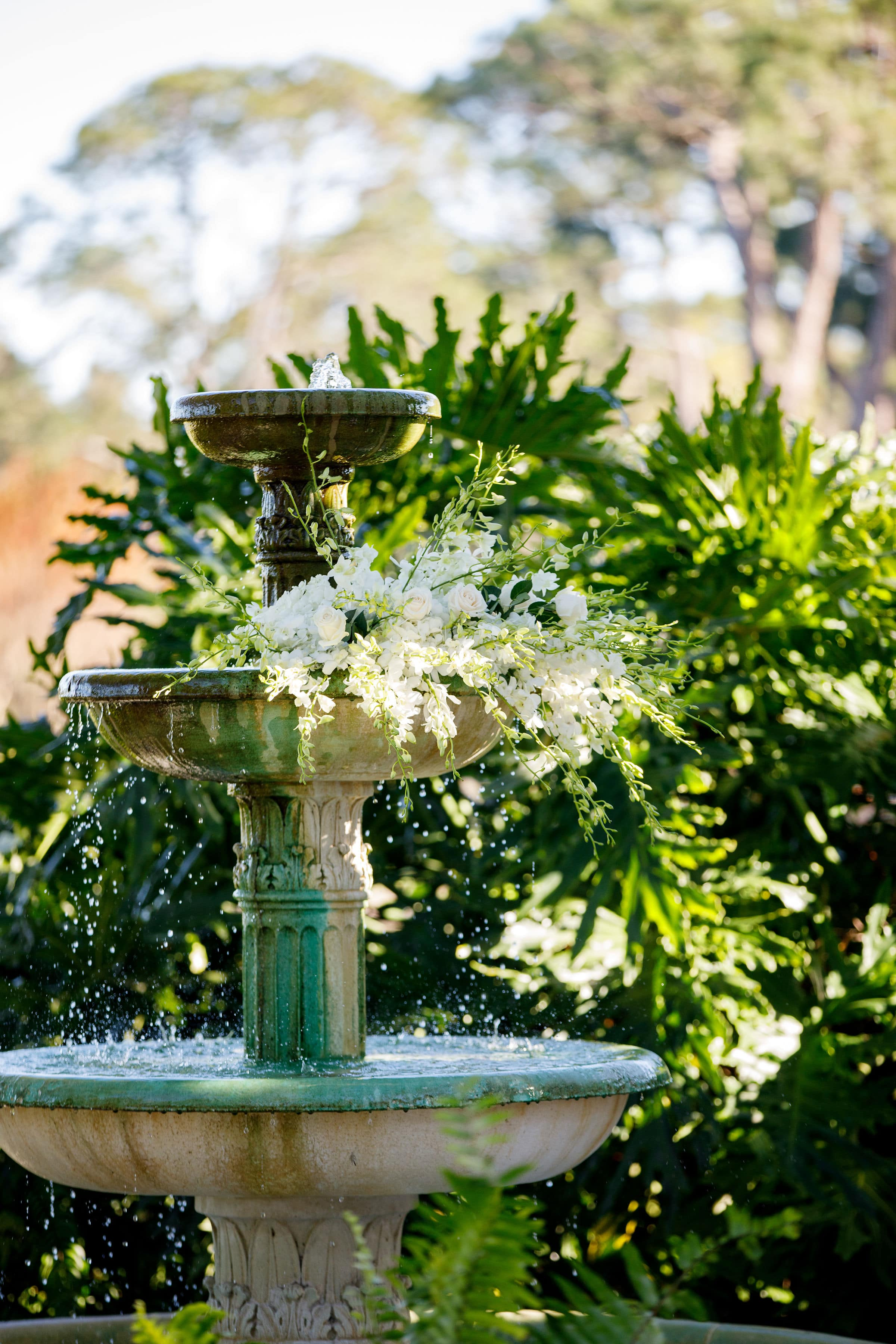 White Floral dripping over European Fountain on Golf Course
