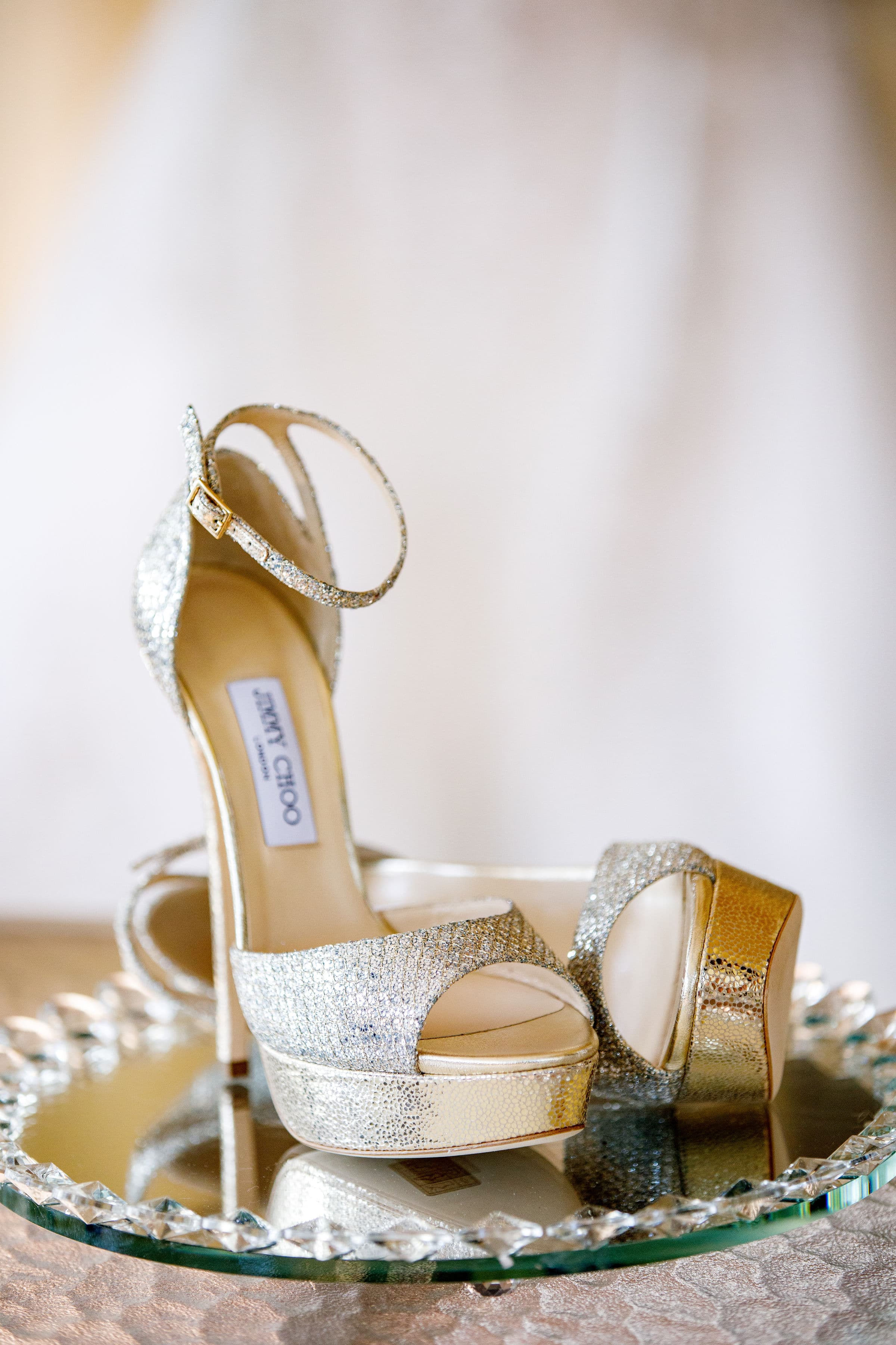 Gold Jimmy Choo Pumps on a Mirrored Tray