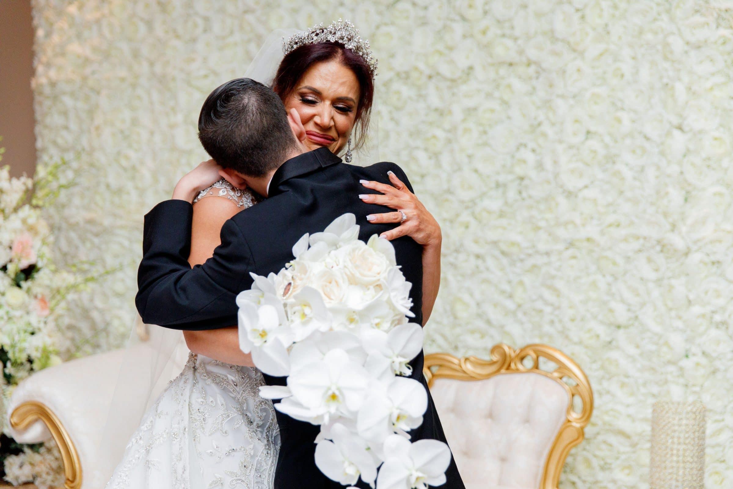 Bride Mother hugging her son