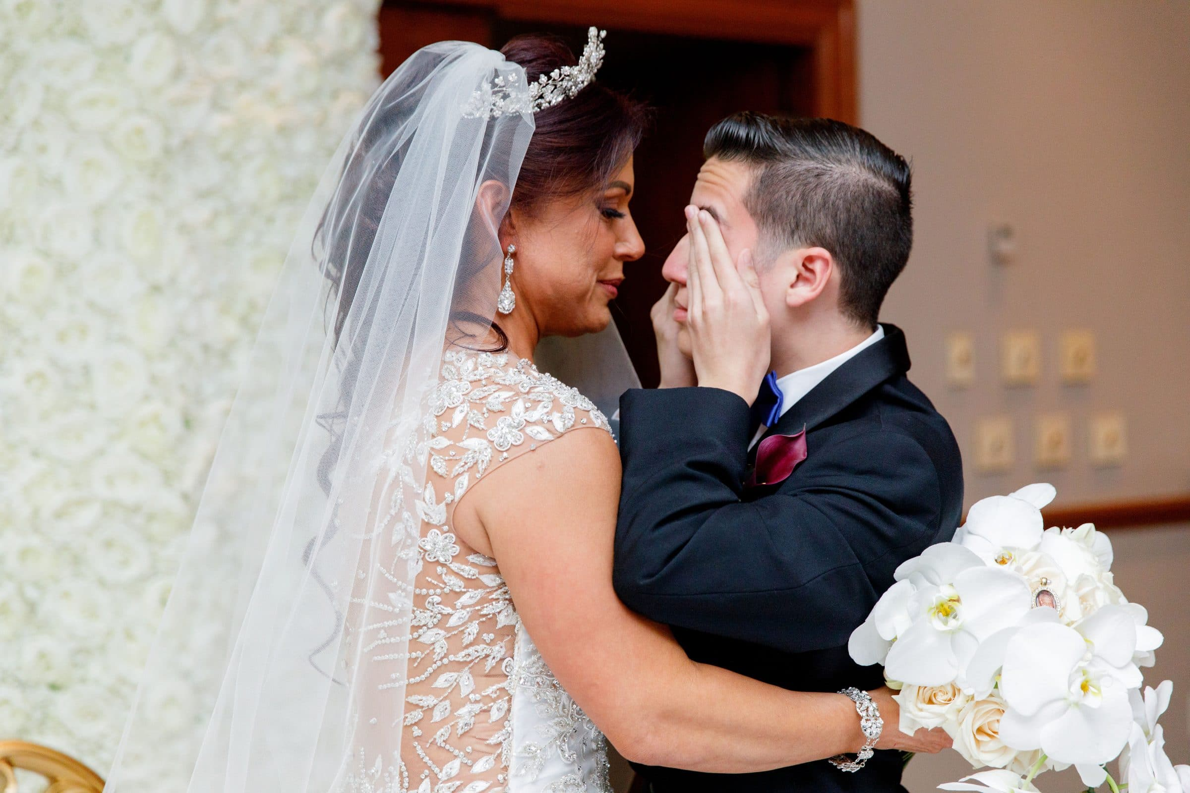 Bride hugging her crying son