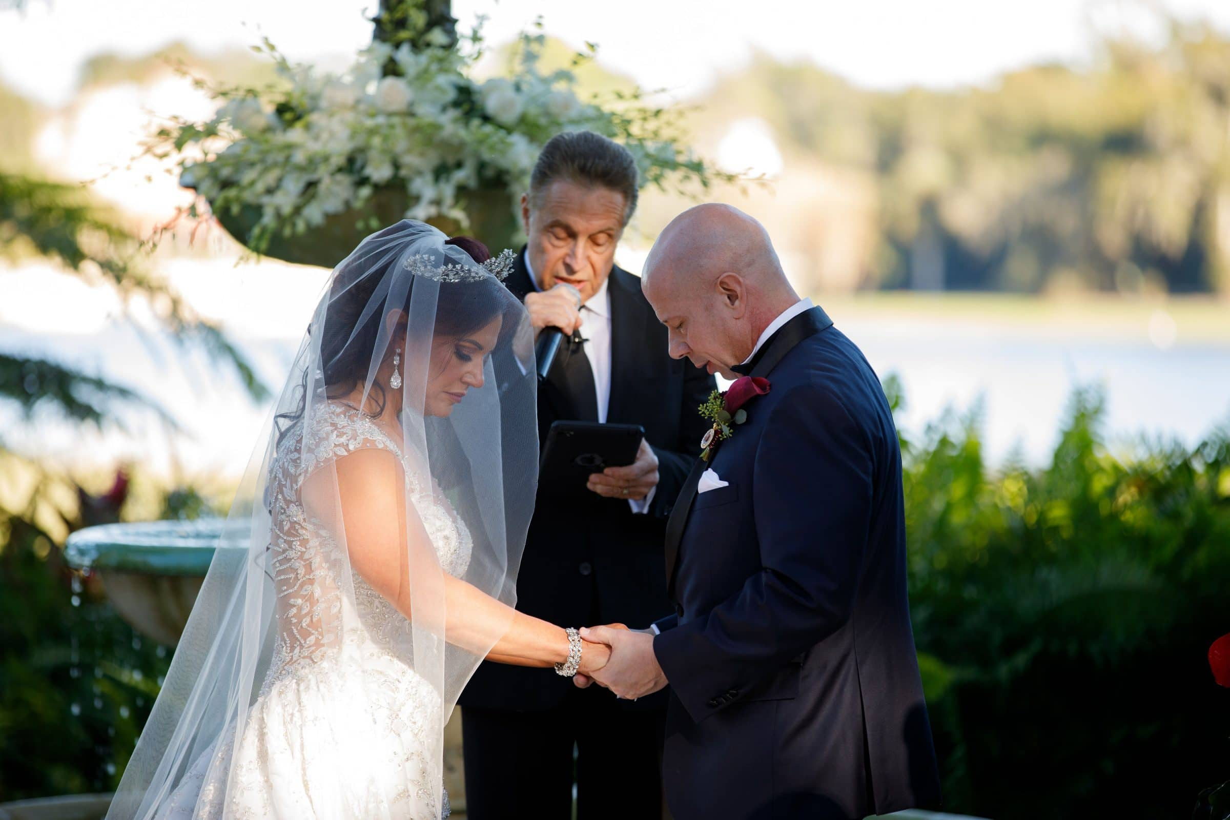 Bride and Groom with Officiant during wedding ceremony
