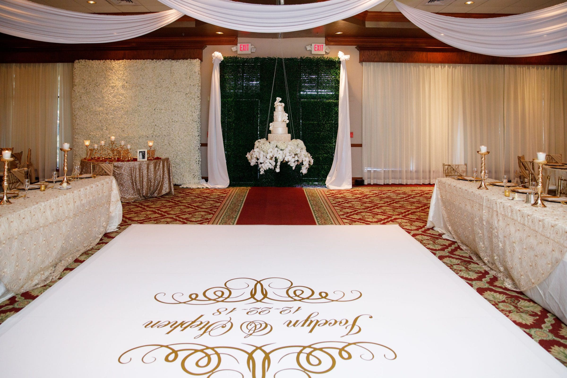 White custom dance floor and hanging cake
