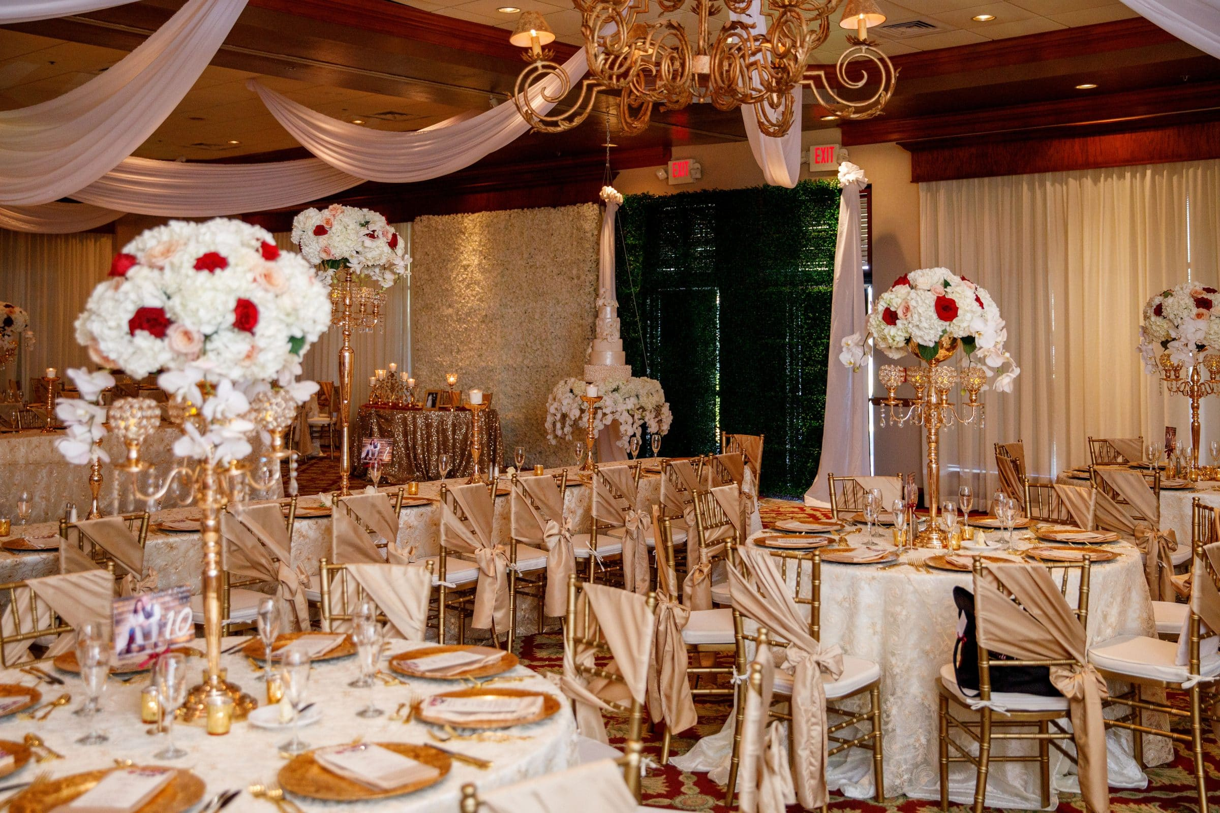 Legends Ballroom with ivory, gold and burgundy decor with floral