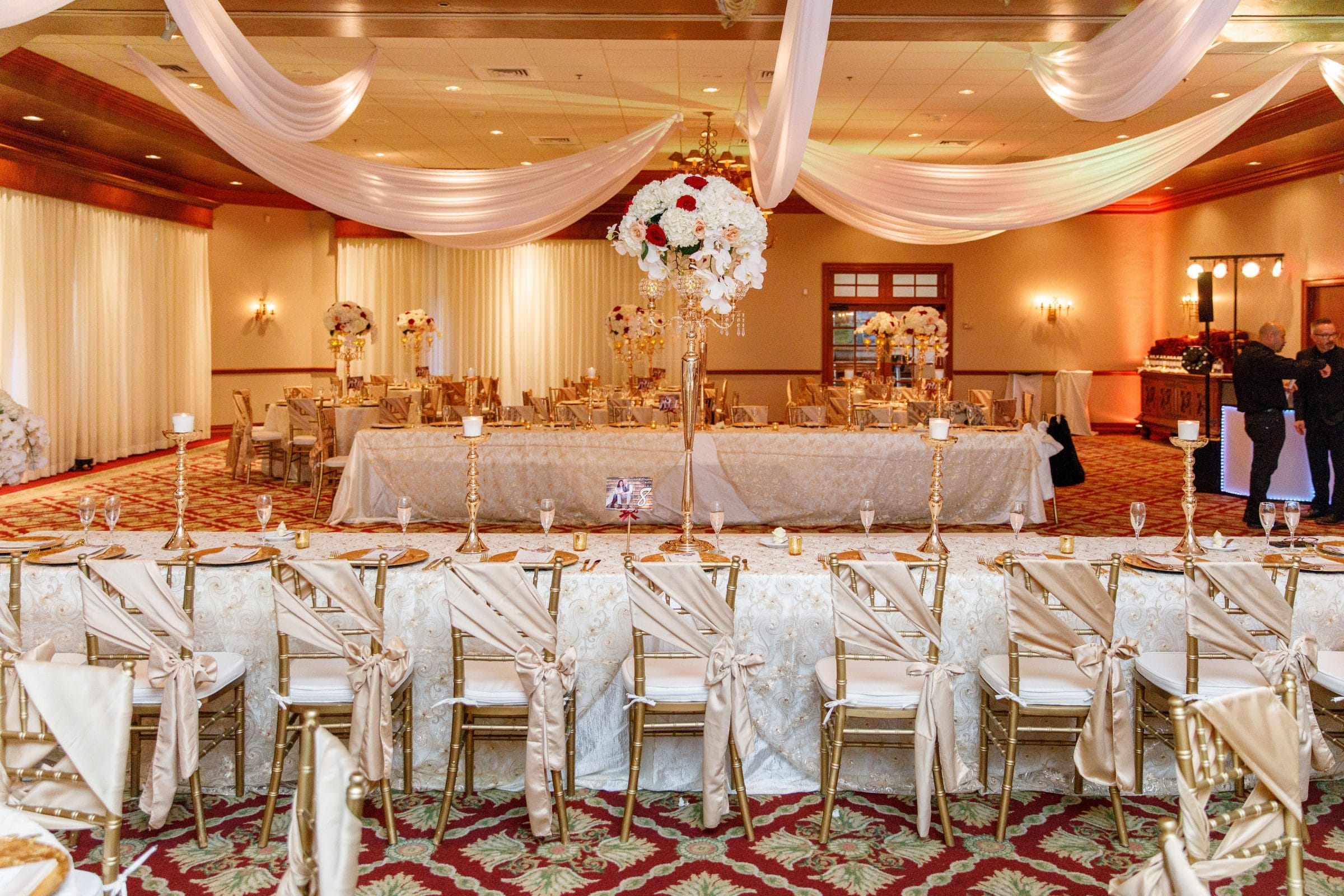 Burgundy and Gold Ballroom with Gold Chairs and White Ceiling Swag