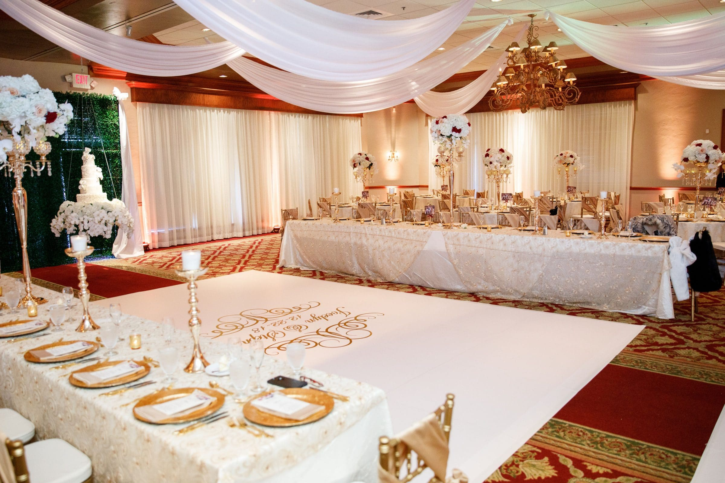 Burgundy and Gold Ballroom with white details