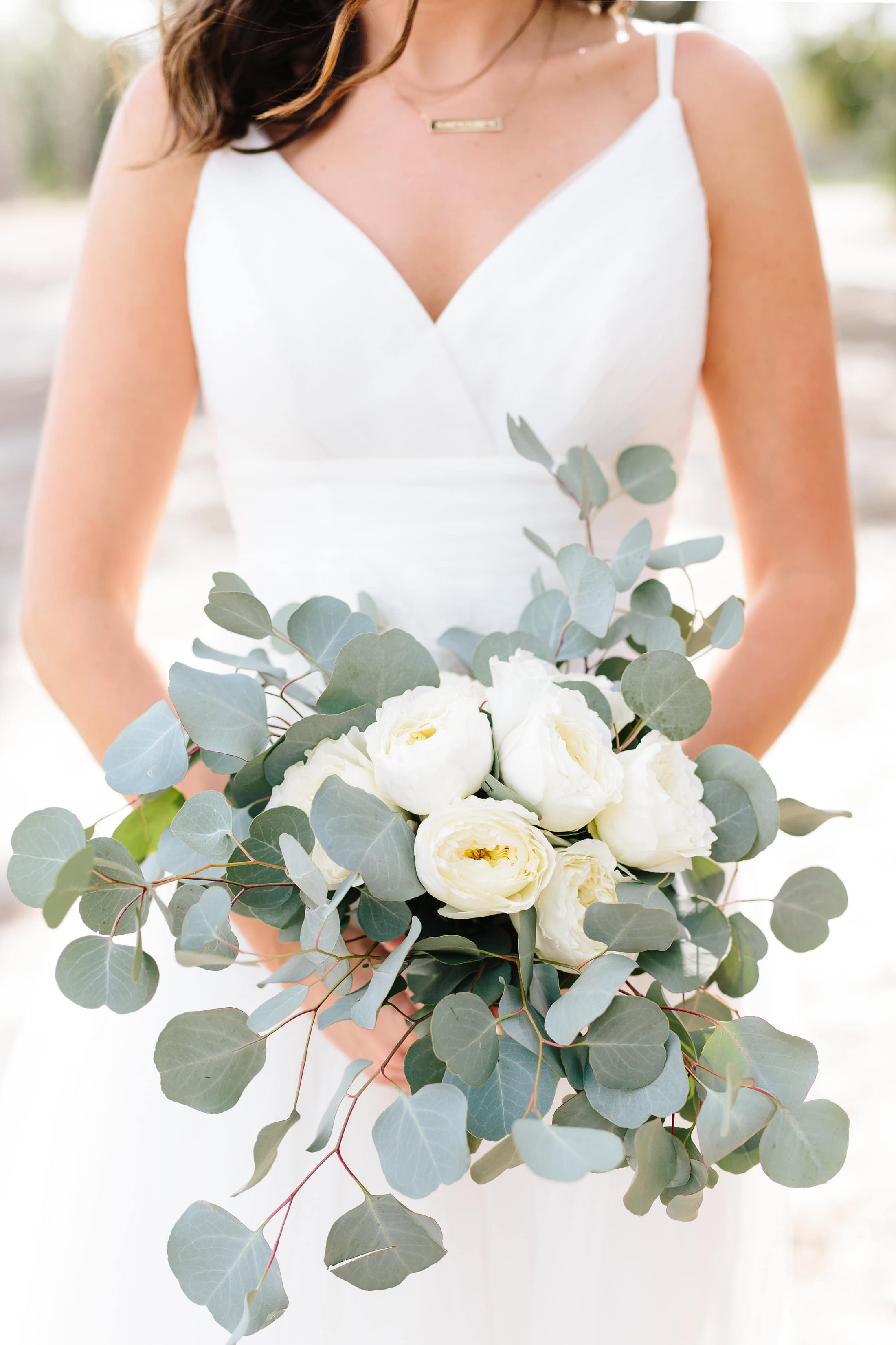 Whimsical Winter Wedding Bouquet with white roses and ecualyptus
