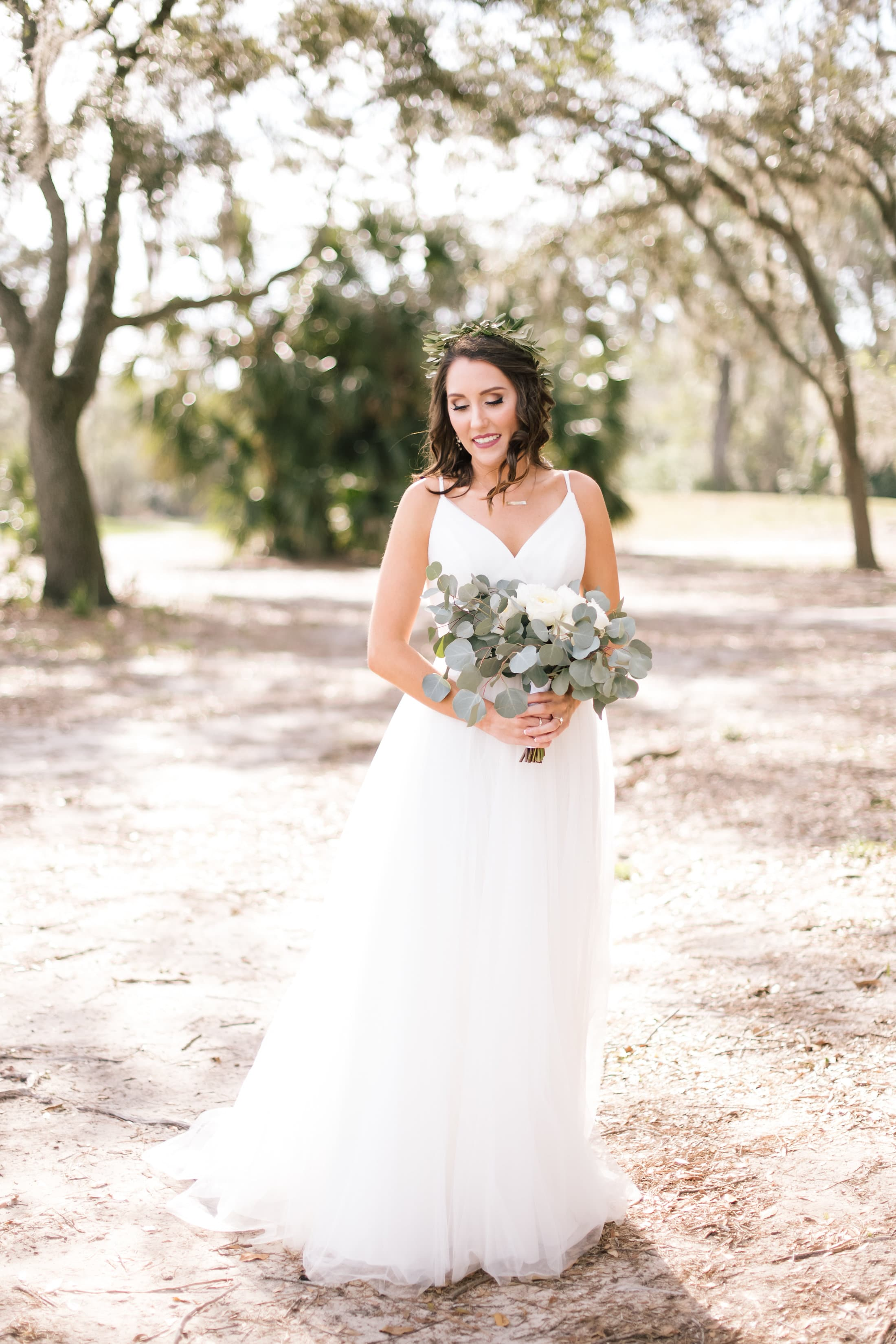 Bride Holding a White Whimsical Winter Wedding Bouquet