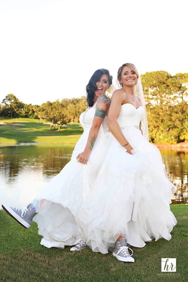 Same Sex Couple in Wedding Dresses on Golf Course