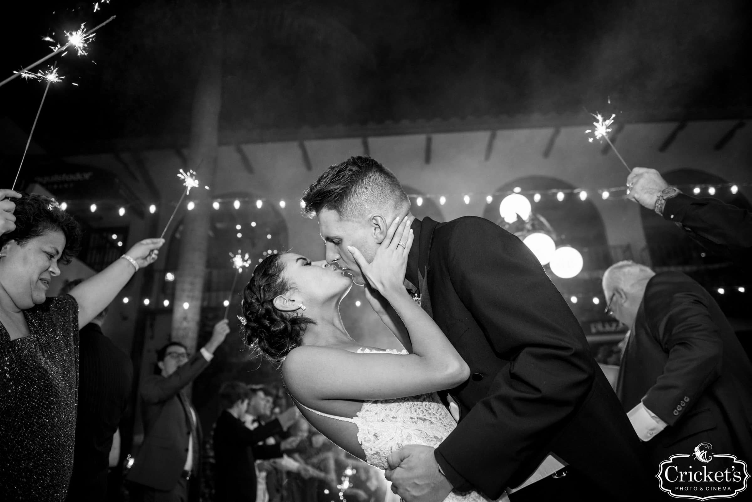 Bride and Groom kissing under sparklers black and white