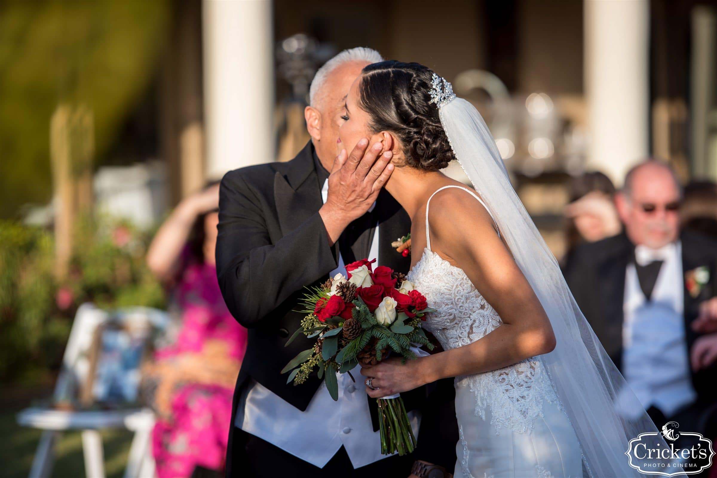 Father of Bride kissing Bride