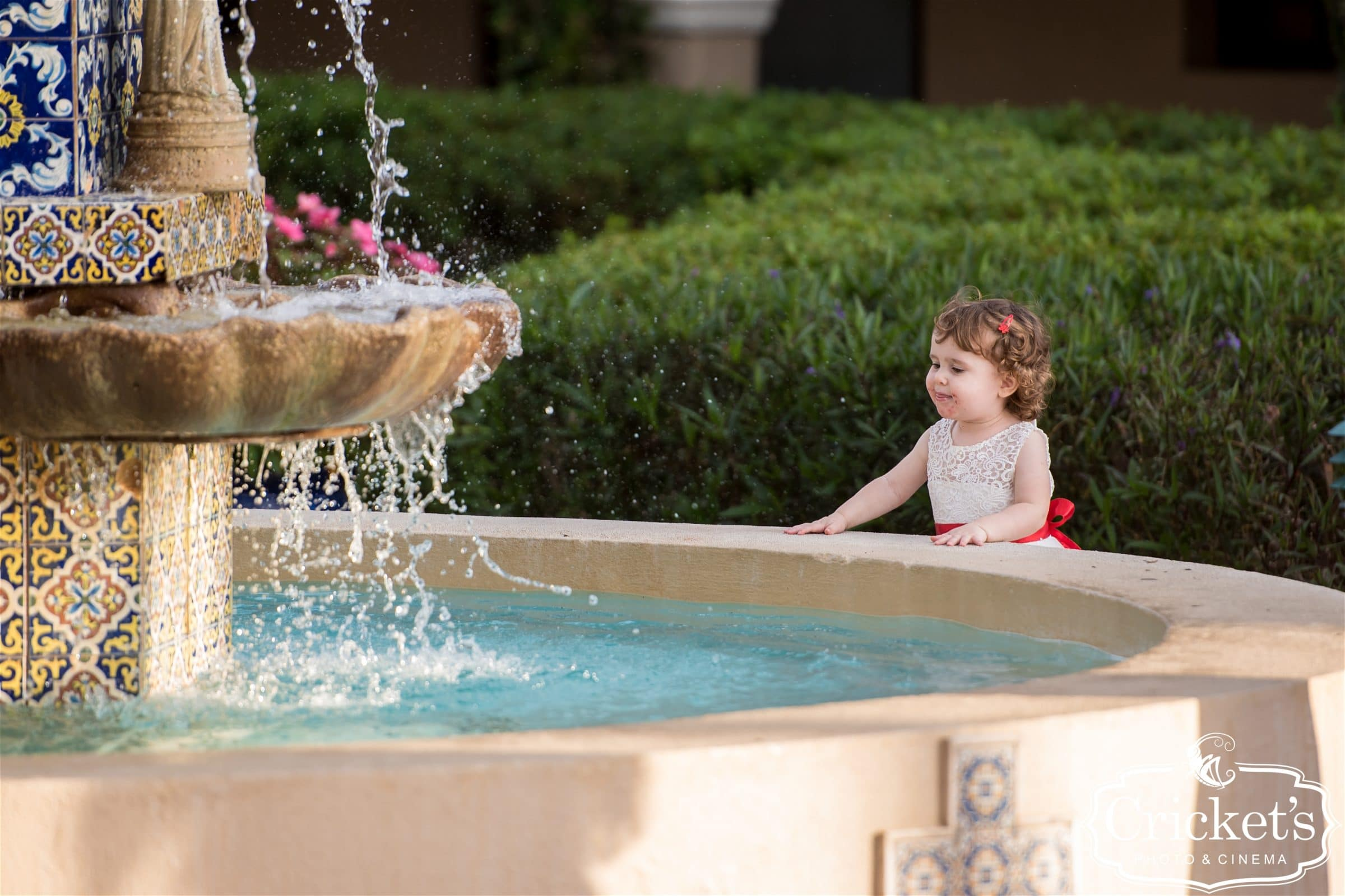 flower girl splashing in fountain