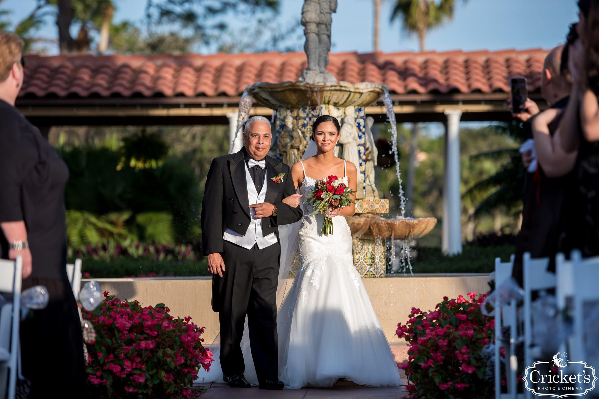 Bride and Father of the Bride walking down the aisle at central florida's mission inn resort plaza de la fontana