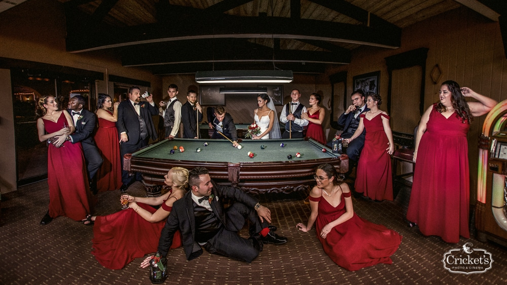 bridal party at end of the night in billiards room