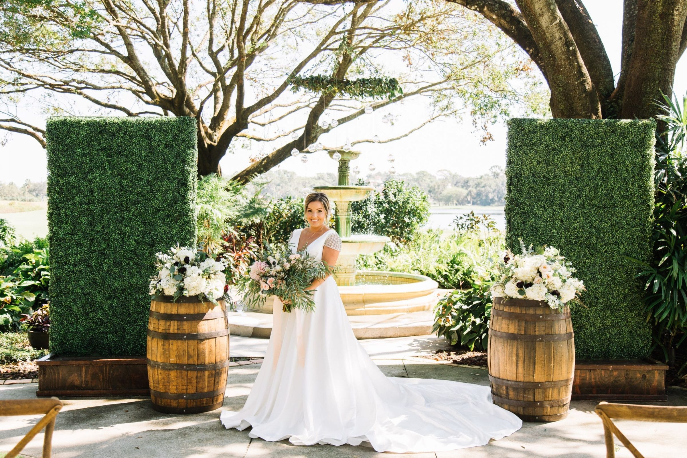 Bride in front of fountain with oak barrels