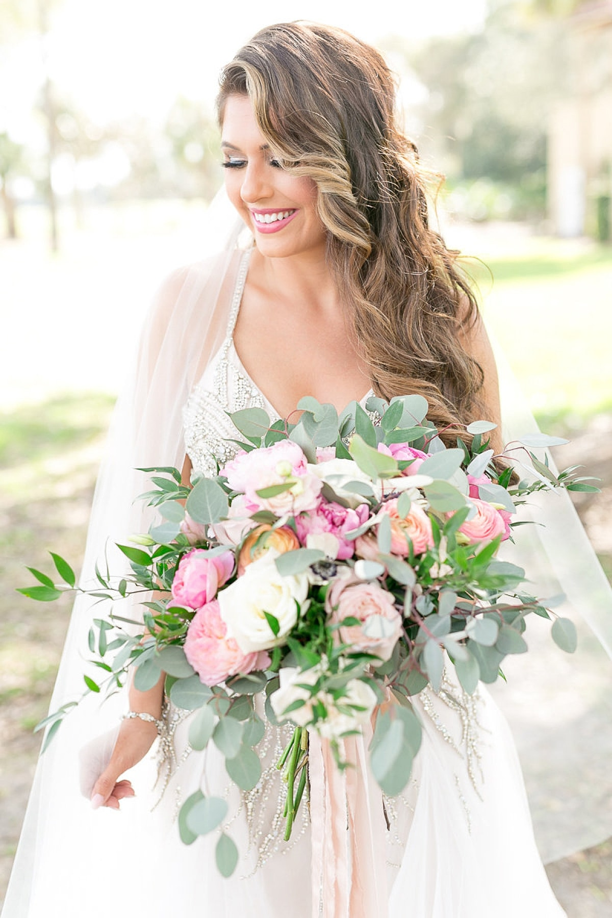 Bride in Hailey Paige Gown holding beautiful wedding bouquet